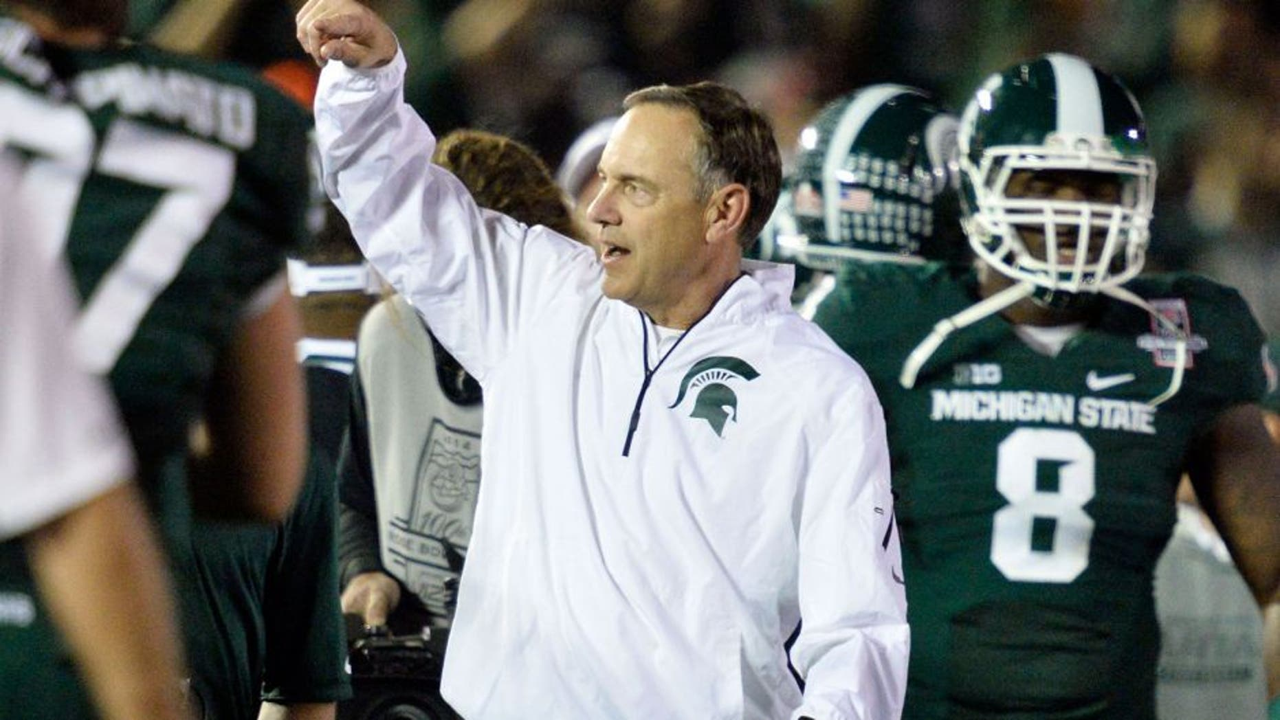 Jan 1, 2014; Pasadena, CA, USA; Michigan State Spartans head coach Mark Dantonio celebrates after Michigan State Spartans beat Stanford Cardinal 24-20 at the Rose Bowl. Mandatory Credit: Robert Hanashiro-USA TODAY Sports