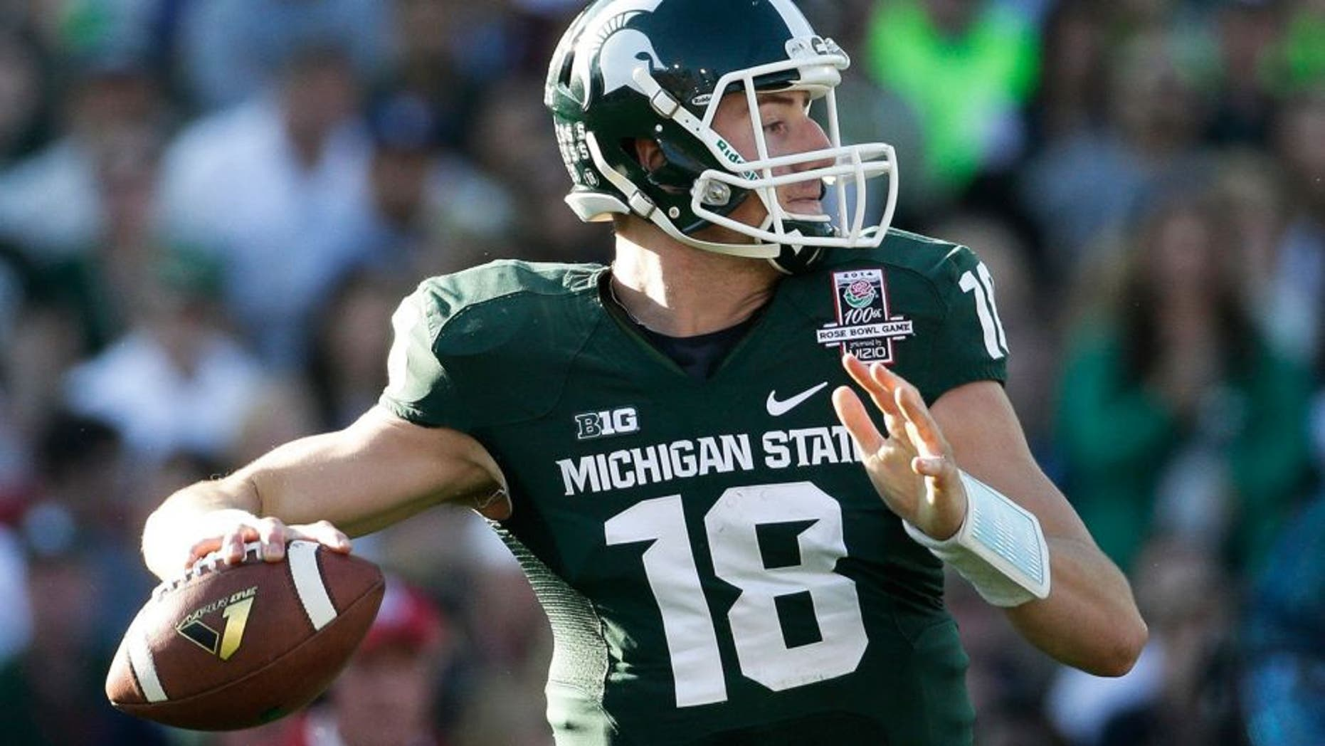 Michigan State quarterback Connor Cook goes back to pass during the first half of the Rose Bowl NCAA college football game against Stanford on Wednesday, Jan. 1, 2014, in Pasadena, Calif. (AP Photo/Jae C. Hong)