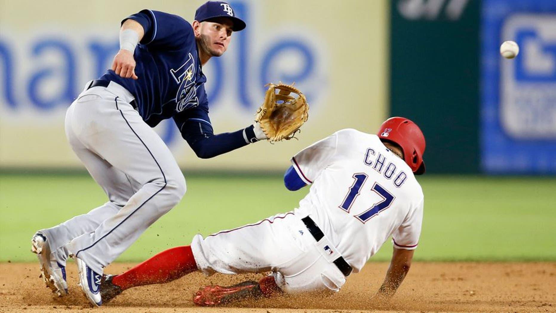 Texas Rangers designated hitter Shin-Soo Choo (17) steals second base against Tampa Bay Rays second baseman Daniel Robertson (29) in the seventh inning at Globe Life Park in Arlington. Mandatory Credit: Tim Heitman-USA TODAY Sports