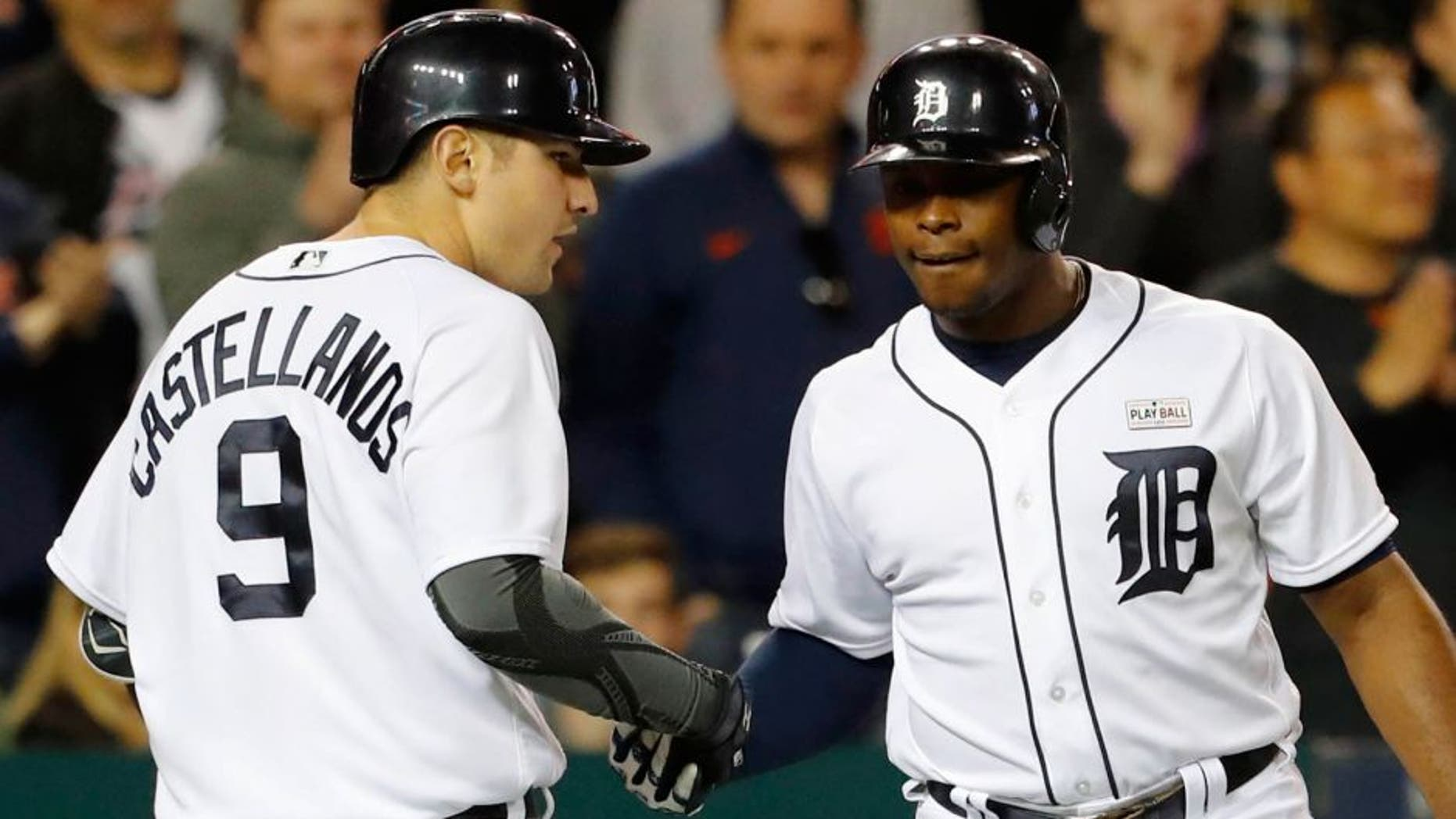 May 16, 2016; Detroit, MI, USA; Detroit Tigers third baseman Nick Castellanos (9) receives congratulations from left fielder Justin Upton (8) after he hits a home run in the seventh inning against the Minnesota Twins at Comerica Park. Mandatory Credit: Rick Osentoski-USA TODAY Sports