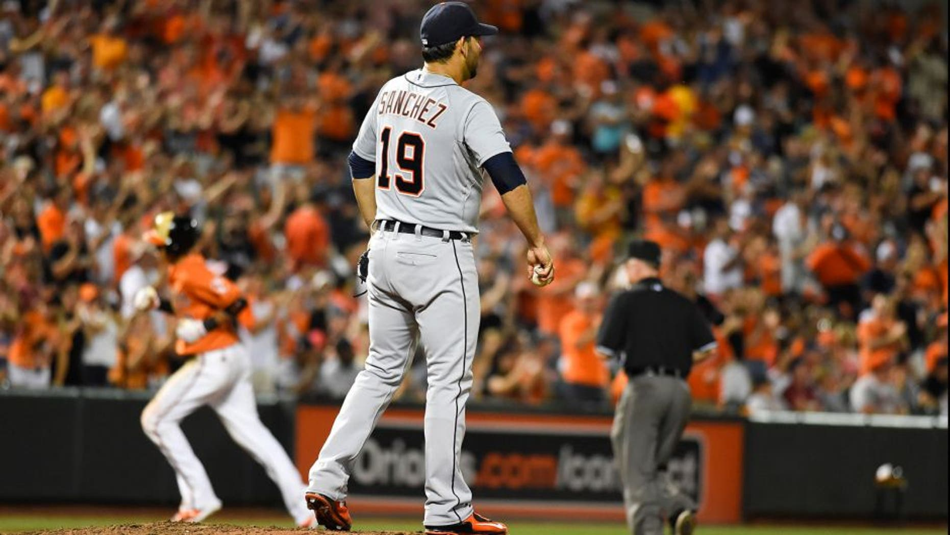 Aug 1, 2015; Baltimore, MD, USA; Detroit Tigers starting pitcher Anibal Sanchez (19) stands on the mound after giving up a two run home to Baltimore Orioles third baseman Manny Machado (13) during the seventh inning at Oriole Park at Camden Yards. Baltimore Orioles defeats Detroit Tigers 6-2. Mandatory Credit: Tommy Gilligan-USA TODAY Sports