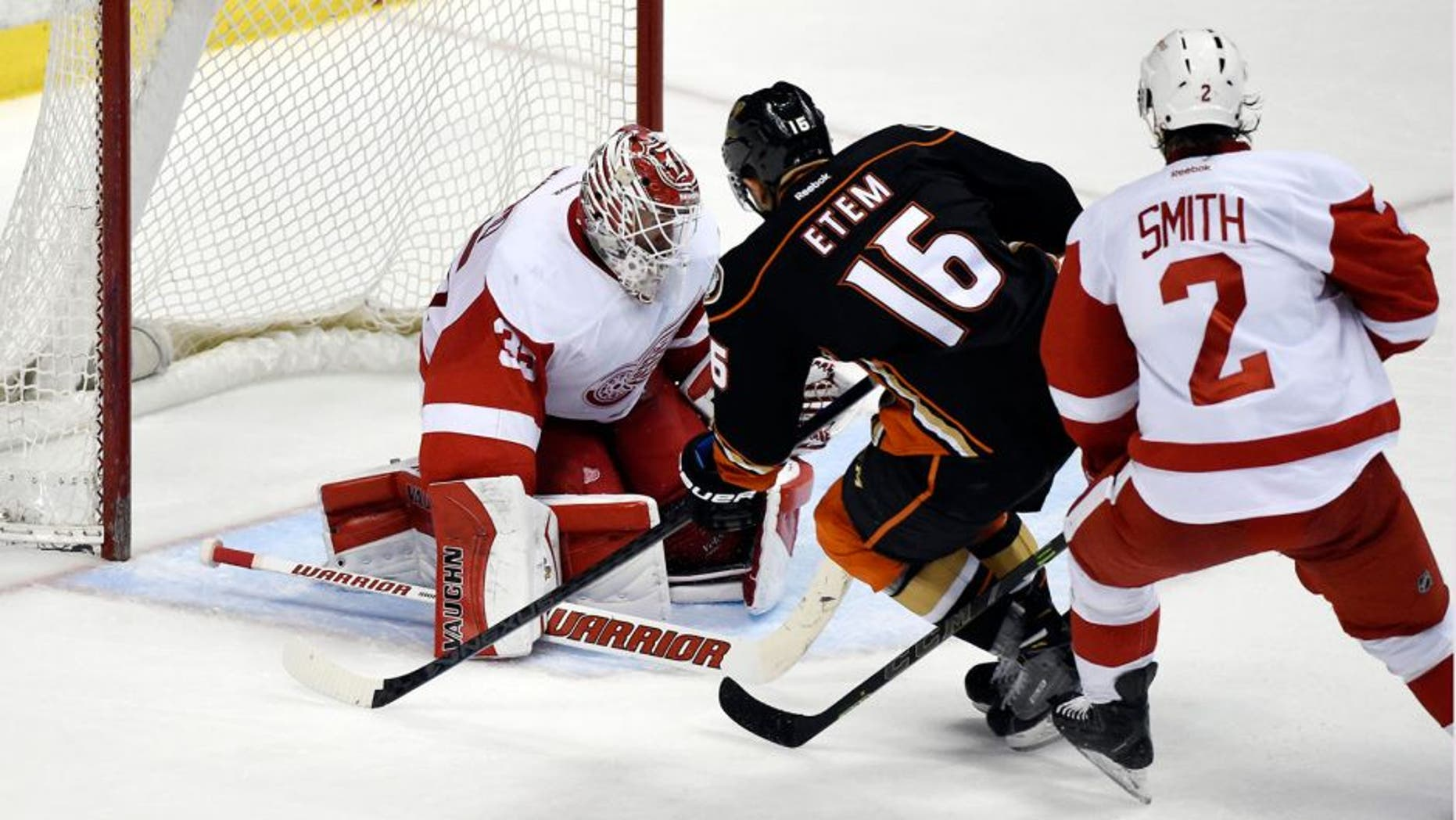 Feb 23, 2015; Anaheim, CA, USA; Anaheim Ducks right wing Emerson Etem (16) scores a goal past Detroit Red Wings goalie Jimmy Howard (35) and defenseman Brendan Smith (2) in the third period during the game at Honda Center. Mandatory Credit: Richard Mackson-USA TODAY Sports