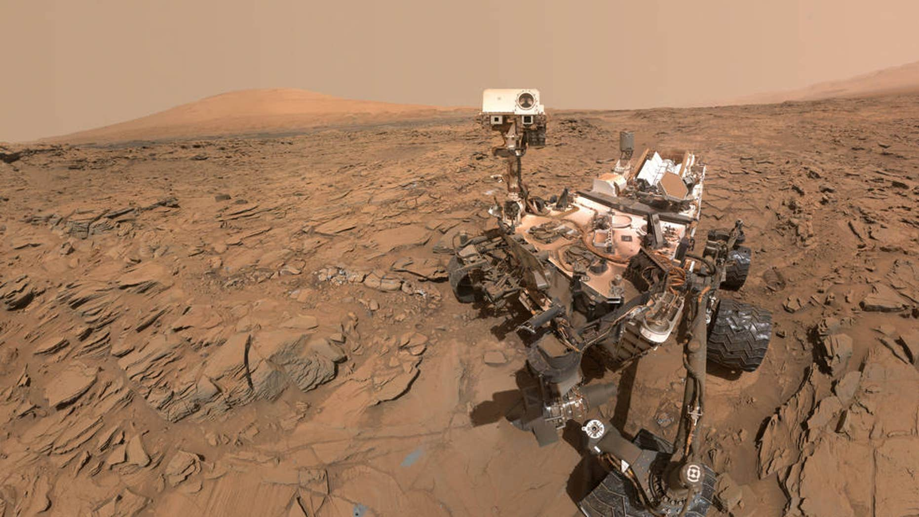 "This selfie of NASA's Curiosity Mars rover shows the vehicle at a drilled sample site called ""Okoruso,"" on the ""Naukluft Plateau"" of lower Mount Sharp. The scene combines several images taken with the rover's Mars Hand Lens Imager (MAHLI) on May 11, 2016, during the 1,338th Martian day, or sol, of the rover's work on the Red Planet."