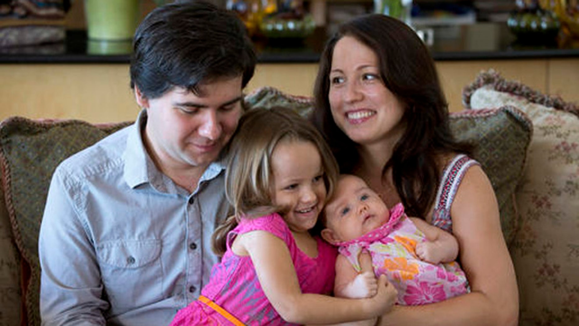 In this 2014 file photo, award-winning concert pianist Vadym Kholodenko, poses with his wife Sofya Tsygankova and daughters Nika, 4, and Michela, at their home in Fort Worth, Texas.