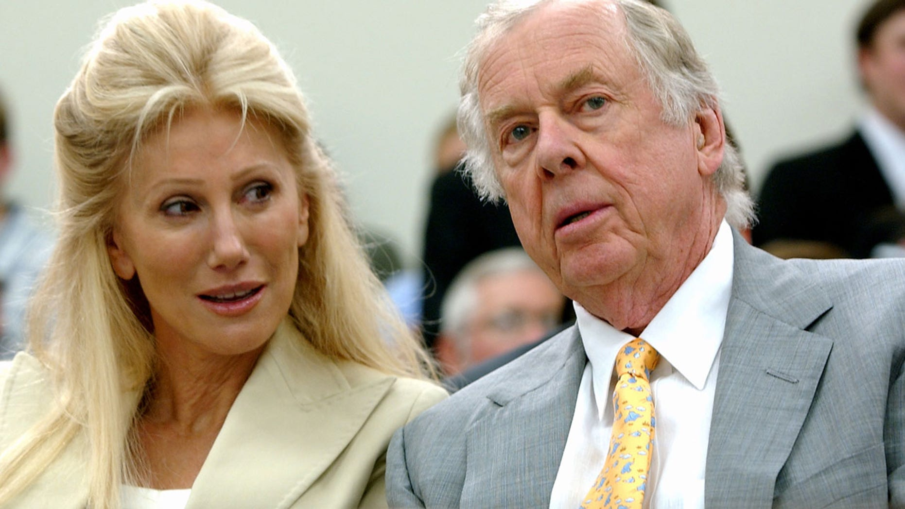 July 25, 2006: Oklahoma energy tycoon T. Boone Pickens, right, with his wife, Madeleine, appear at a House Energy and Commerce subcommittee hearing on Capitol Hill in Washington.