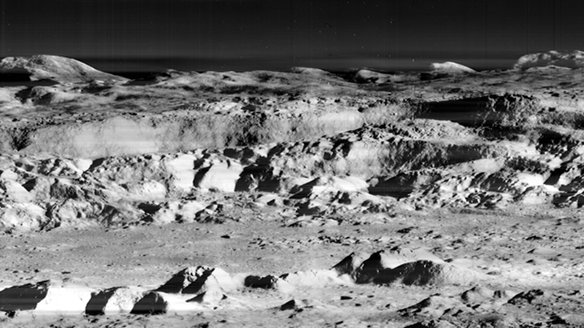 """A 1967 photo of the moon's surface from the Lunar Orbiter 2, taken in 1967, that was widely described as """"the picture of the century."""""""
