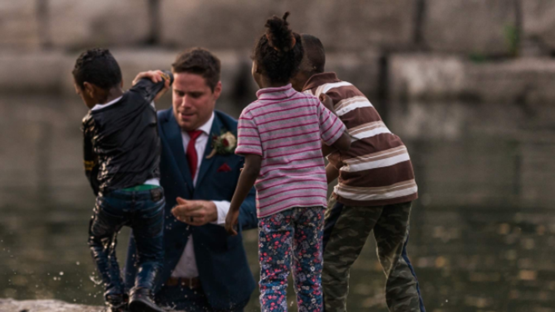Canadian groom Clayton Cook stopped posing for wedding photos to save a young boy drowning in a pond Friday.