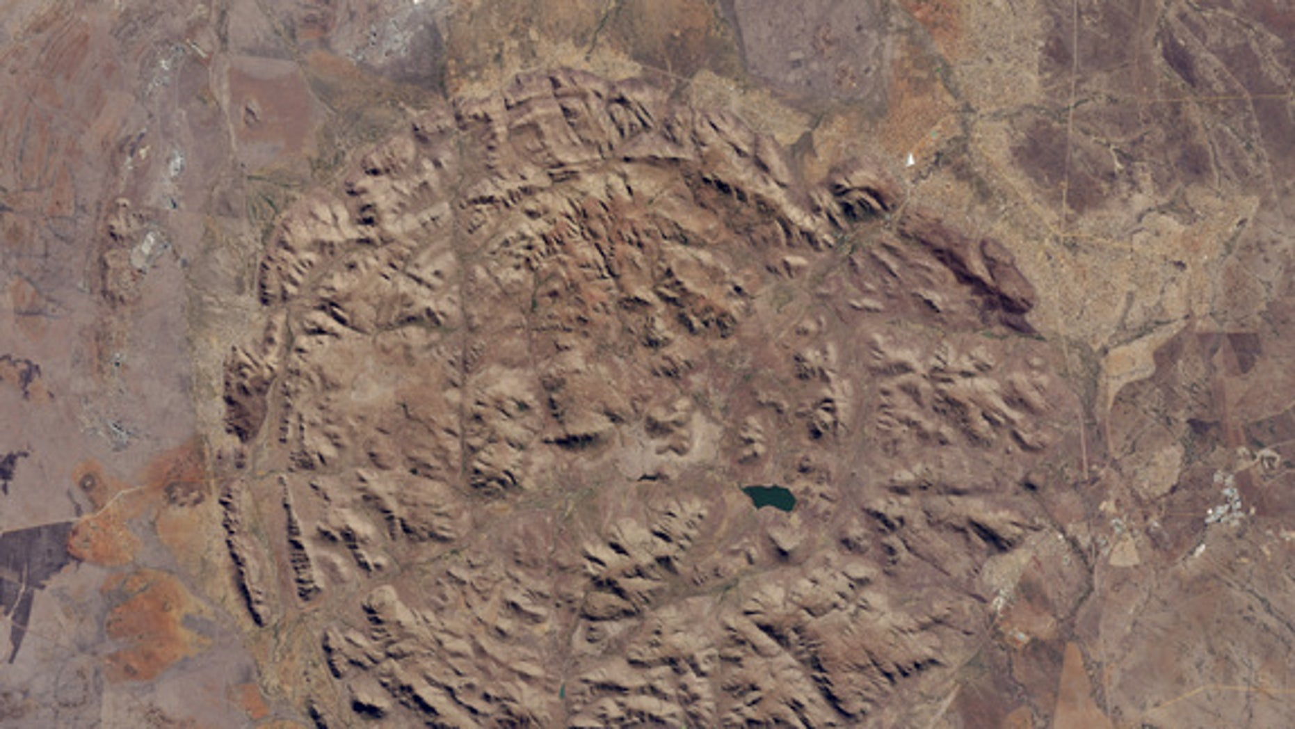 Aerial image of the Pilanesberg National Park in South Africa captured by the Operational Land Imager on Landsat 8 by NASA Earth Observatory.