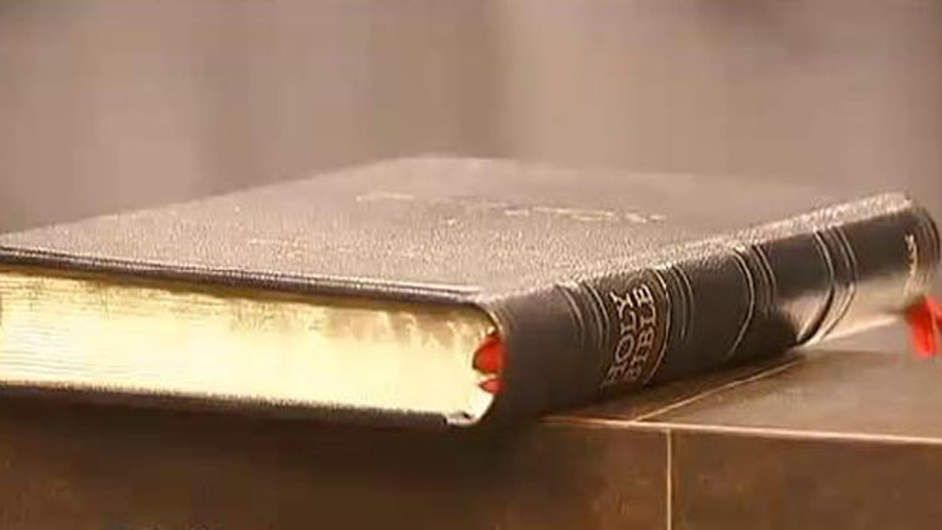 An atheist group is fighting to remove this Bible from Pinellas Park's city council chamber.