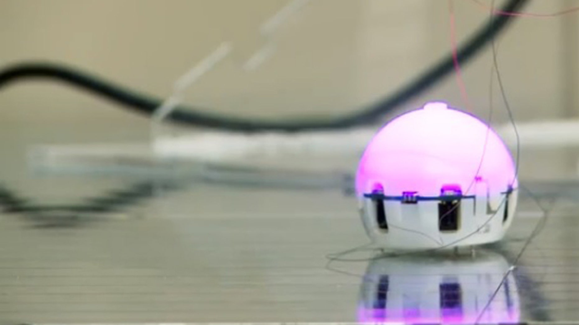 A ping-pong ball sized robot, designed to join with its mates and self-assemble.