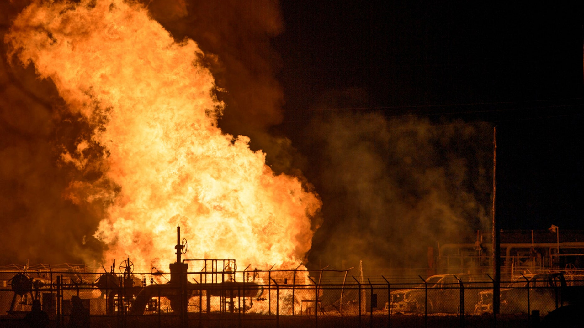 Vehicles and a power pole smoke next to a fire at the Phillips 66 pipeline in Paradis, La. Thursday, Feb. 9, 2017.