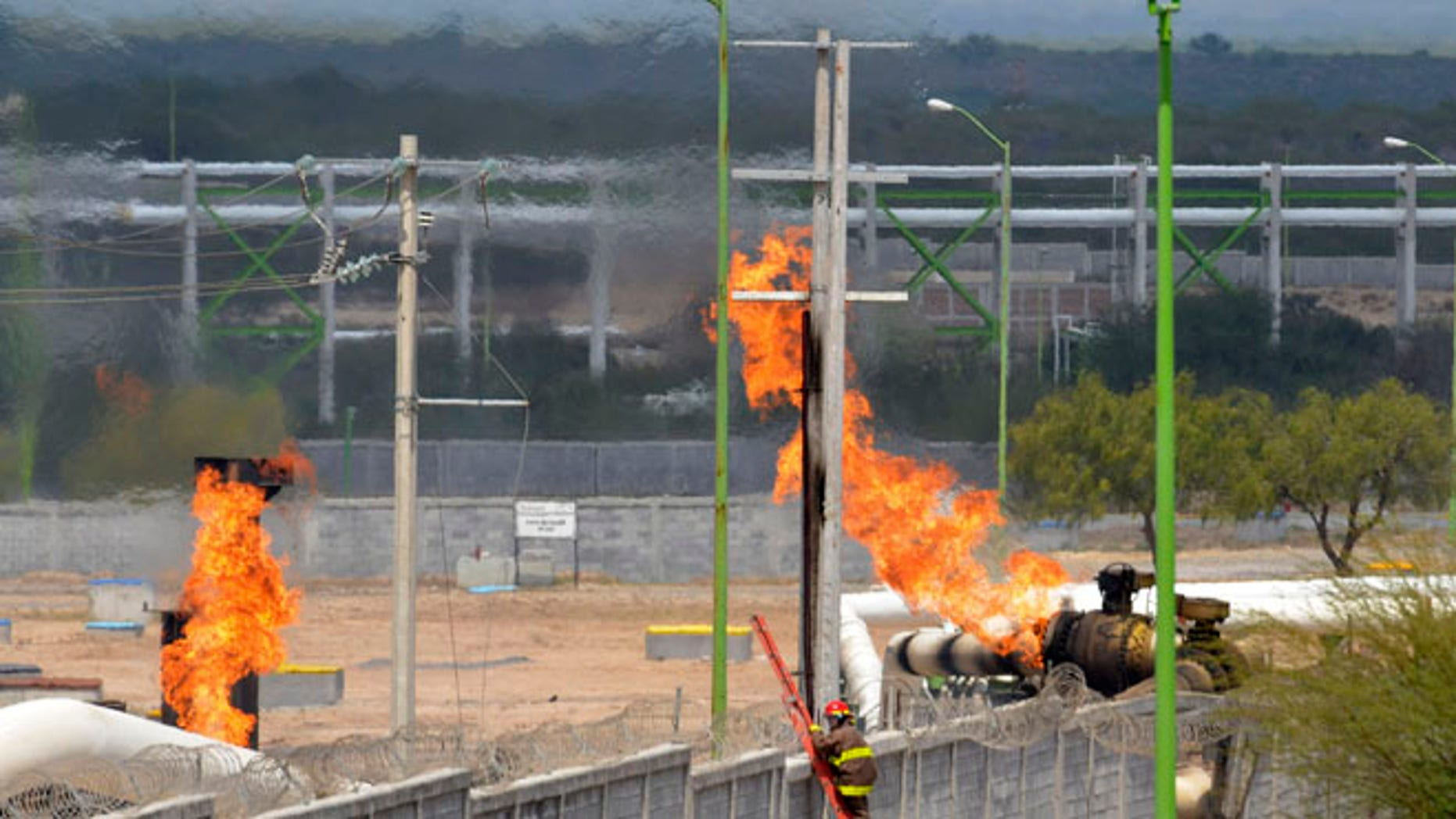 Sept. 18, 2012: Firefighter climb a ladder as they try to control a fire after an explosion at a gas pipeline distribution center in Reynosa, Mexico near Mexico's border with the United States.