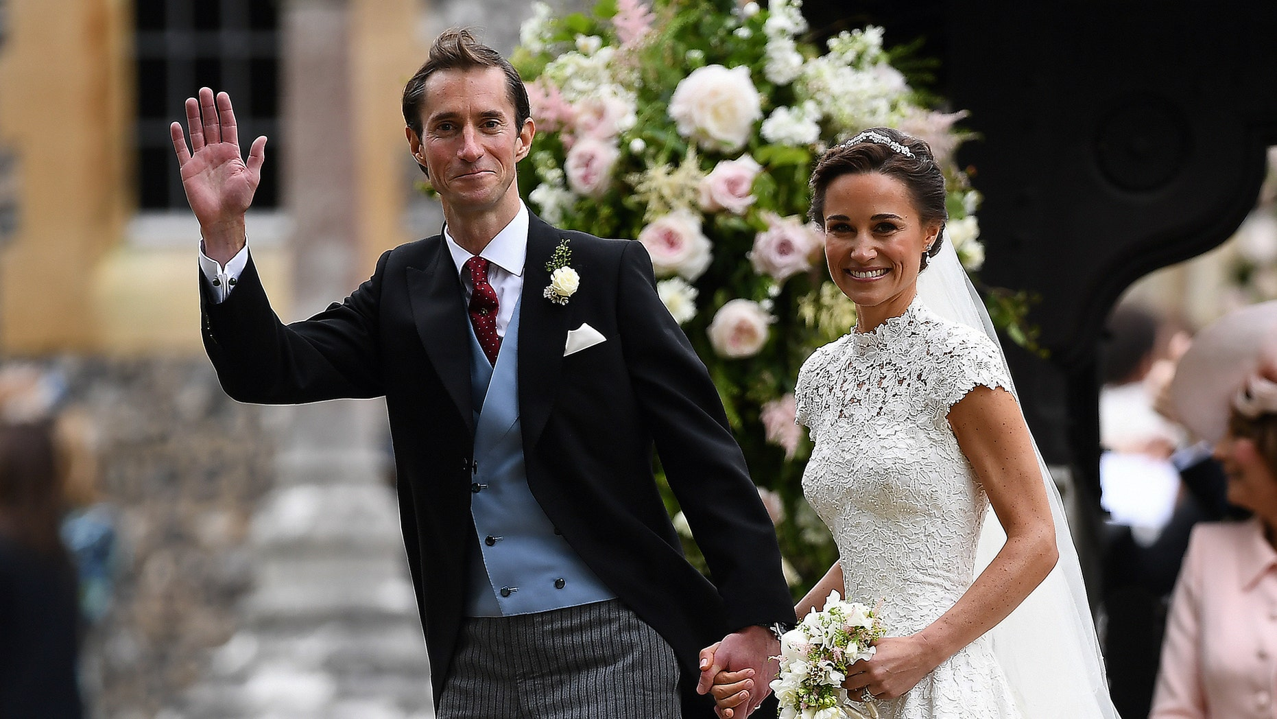 Pippa Middleton and her new husband, James Matthews, smile following their wedding ceremony at St Mark's Church in Englefield, west of London, on May 20, 2017.