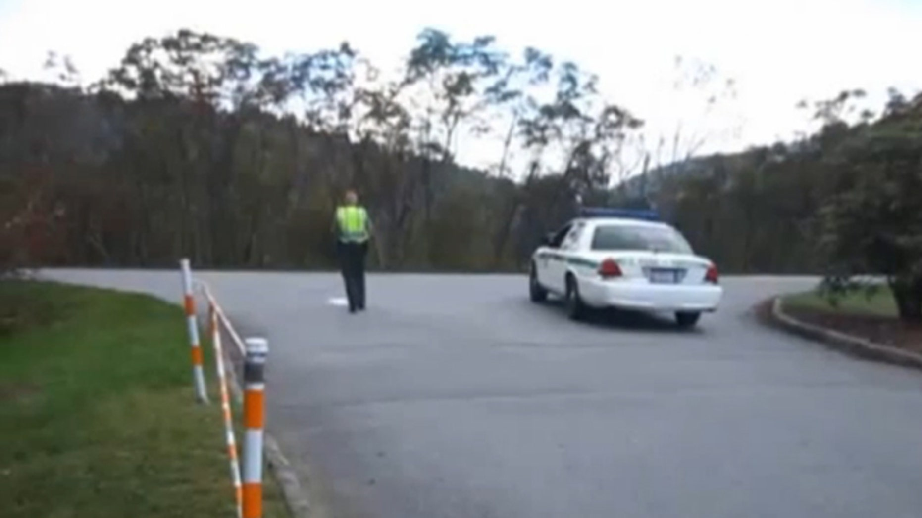 Shown here is an image, from video, of rangers blocking the parking lot to the Pisgah Inn in North Carolina.