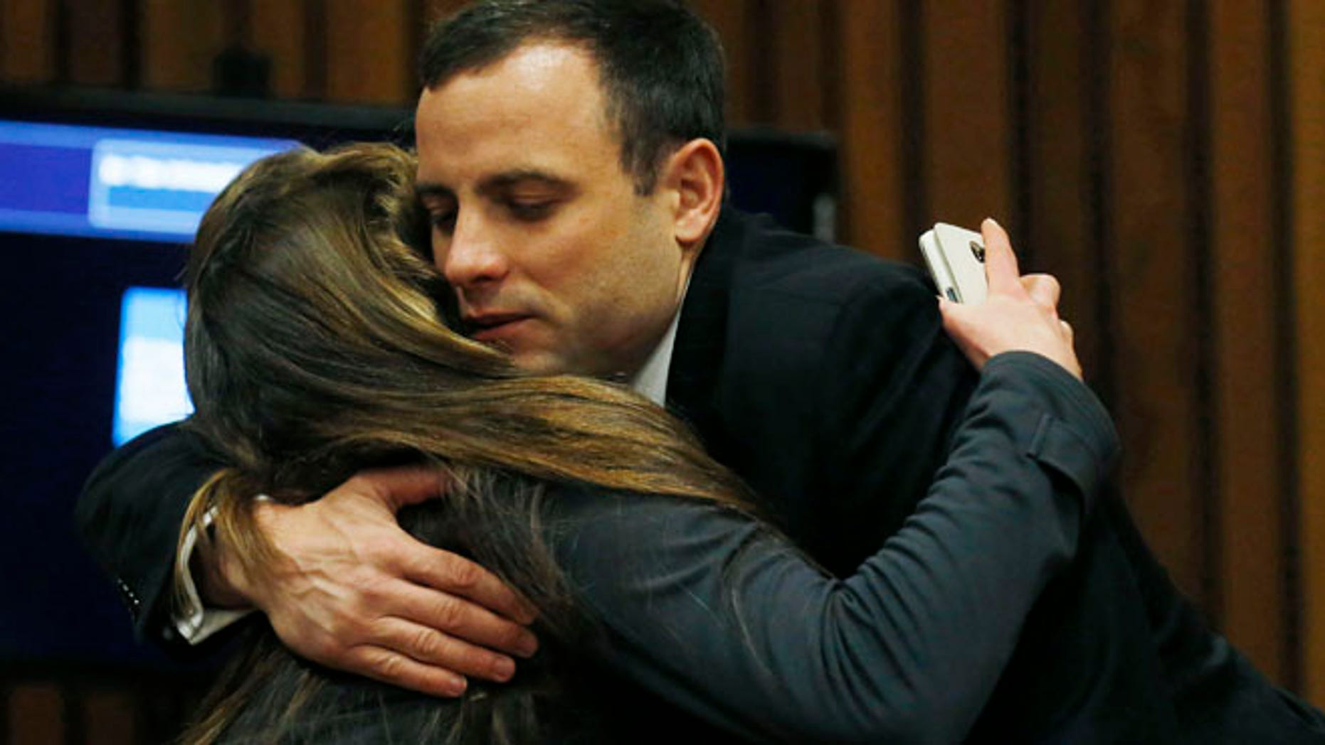 July 1, 2014: Oscar Pistorius is greeted by a well-wisher at a court in Pretoria, South Africa.