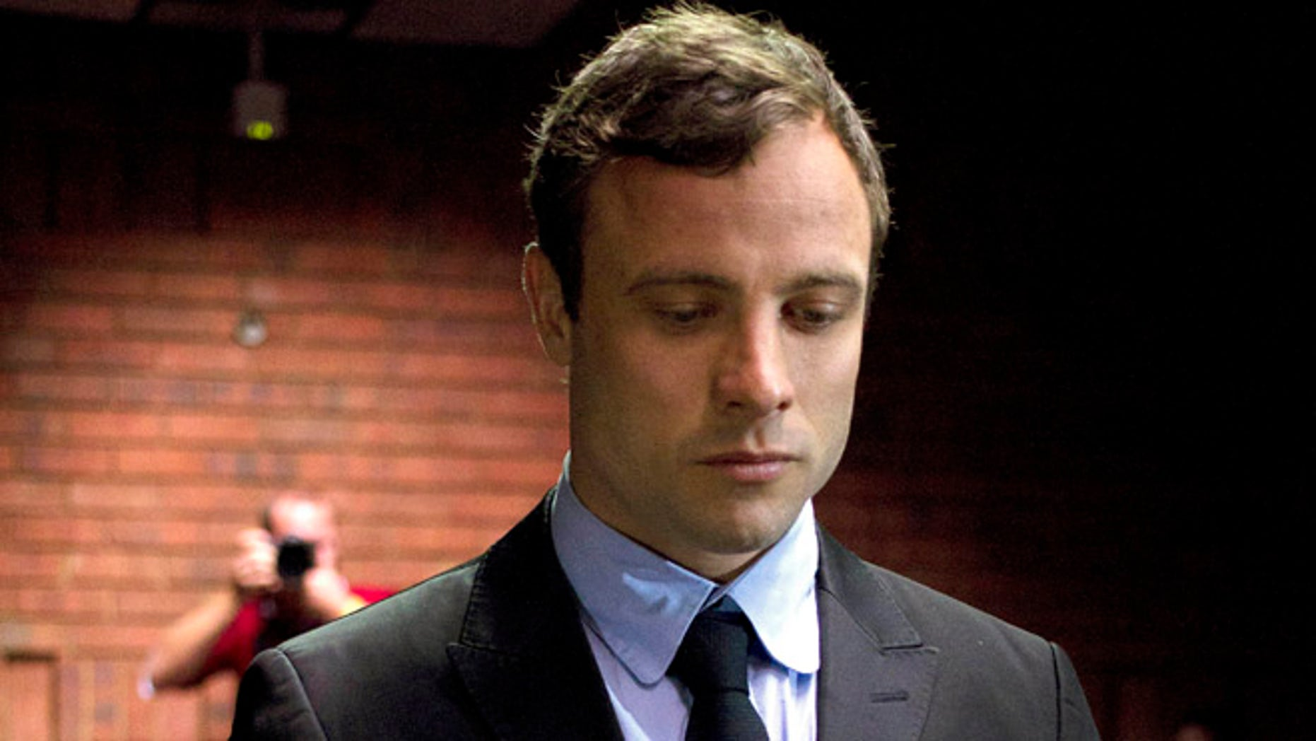 Aug. 19, 2013 Double-amputee Olympian Oscar Pistorius appears at the magistrates court to be indicted on charges of murder and illegal possession of ammunition for the shooting death of his girlfriend on Valentine's Day in Pretoria, South Africa.