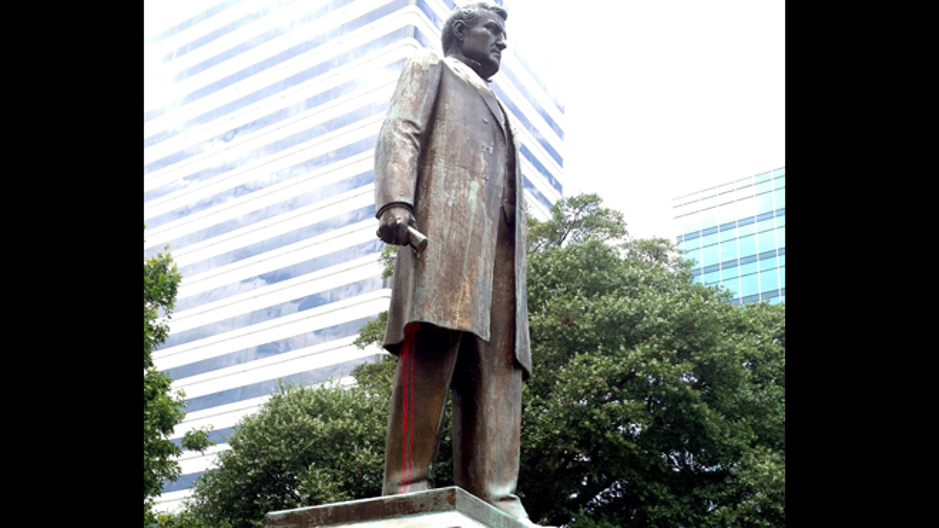 """June 30, 2015: Red paint drips from the statue of """"Pitchfork"""" Ben Tillman, in Columbia, S.C."""