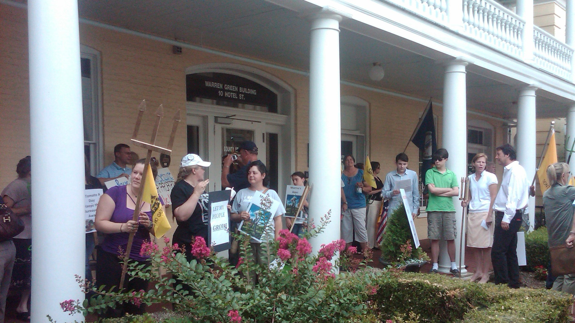 """Farmers gather at a  Board of Zoning Appeals meeting in  Fauquier County Virginia to hold a """"Pitchfork Protest"""" in support of Liberty Farms owner Martha Boneta."""