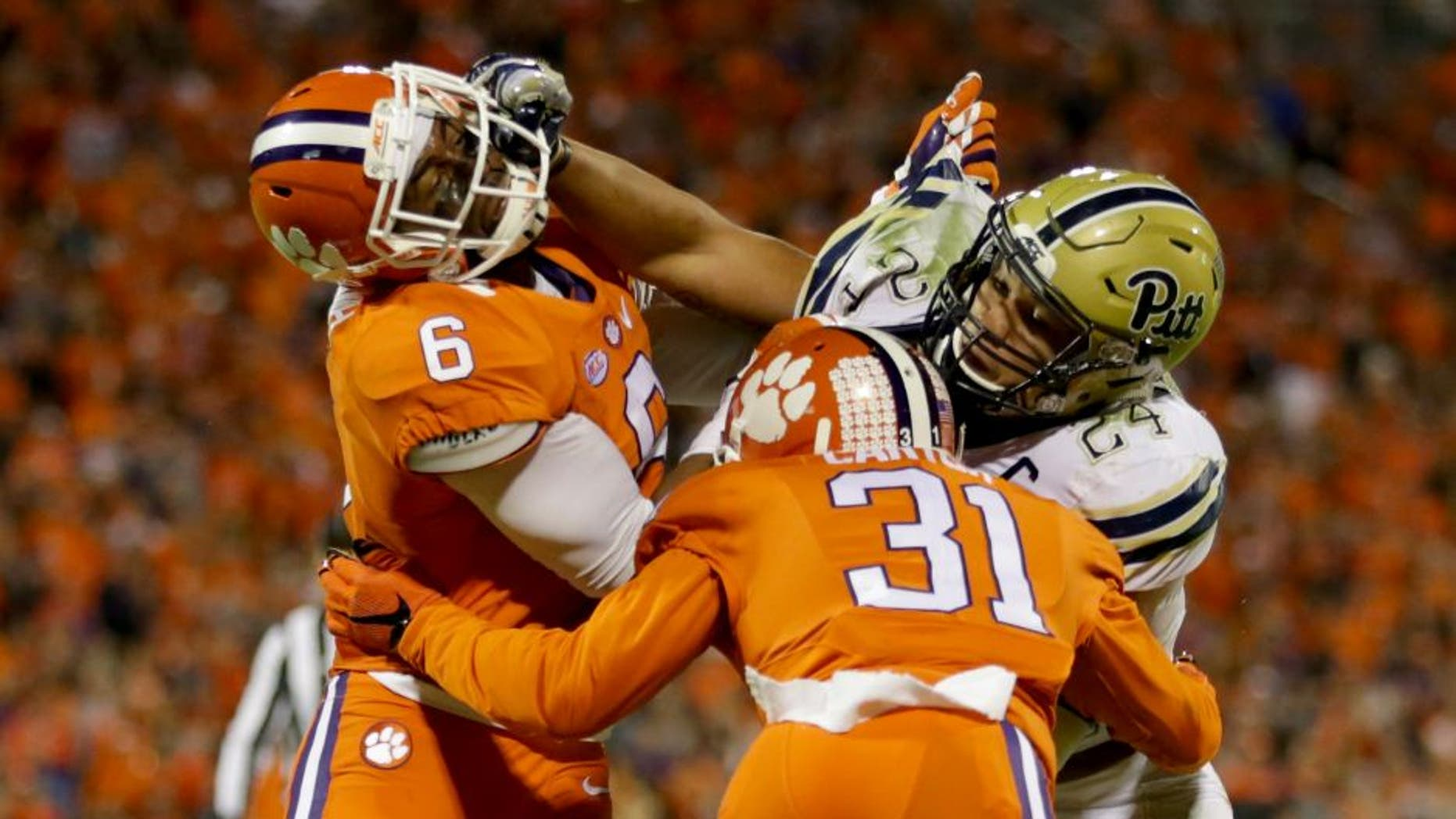 CLEMSON, SC - NOVEMBER 12: Teammates Dorian O'Daniel #6 and Ryan Carter #31 of the Clemson Tigers try to stop James Conner #24 of the Pittsburgh Panthers during their game at Memorial Stadium on November 12, 2016 in Clemson, South Carolina. (Photo by Streeter Lecka/Getty Images)