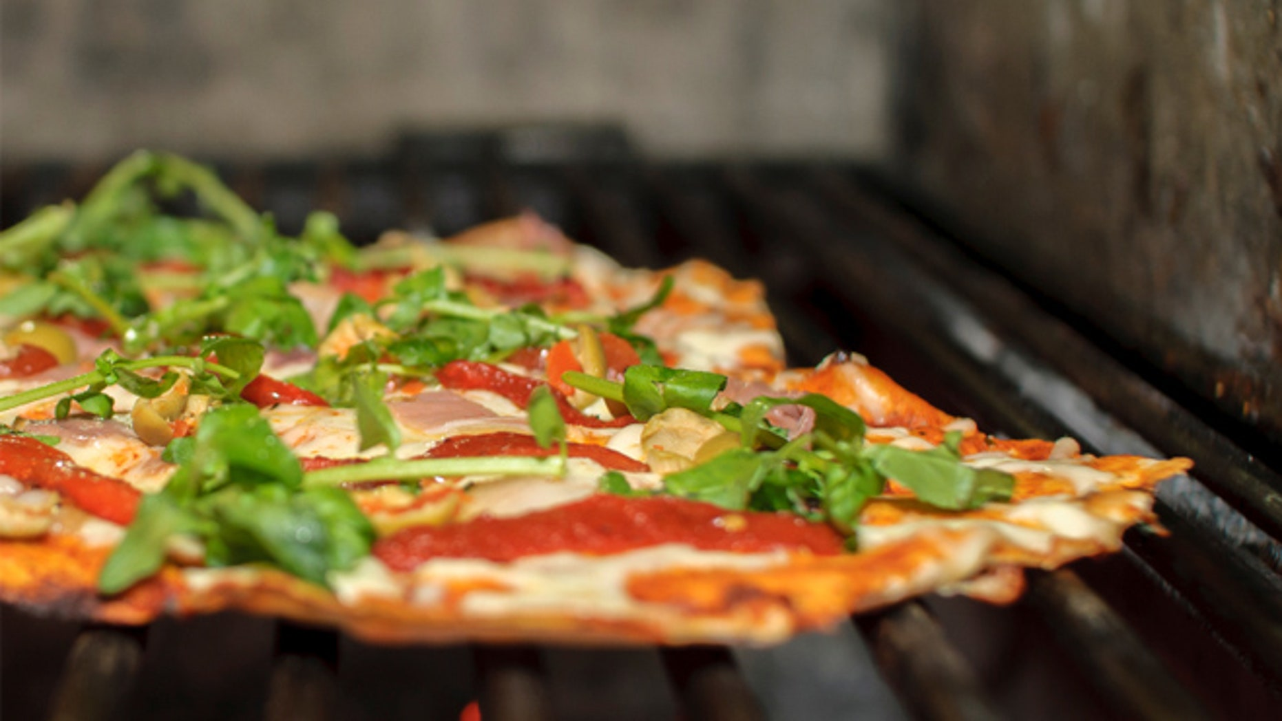 It's easier than you think to turn your outdoor grill into a pizza oven.