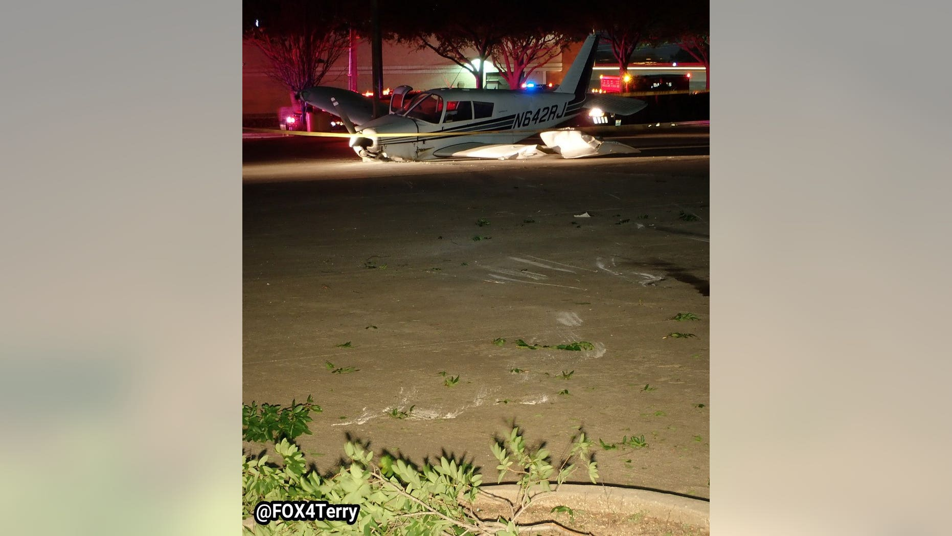 The pilot had planned to make an unscheduled landing in Addison, Texas, before coming down in the lot.