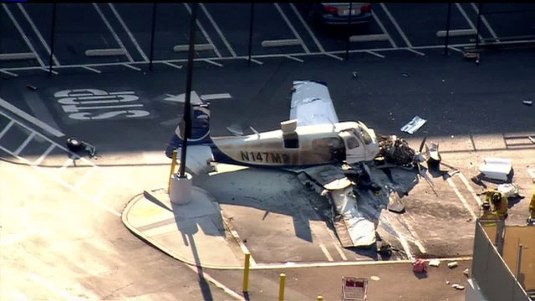 July 30, 2014: The wreckage of a small plane is shown in a Costco parking lot in San Diego. (Courtesy Fox5SanDiego.com)