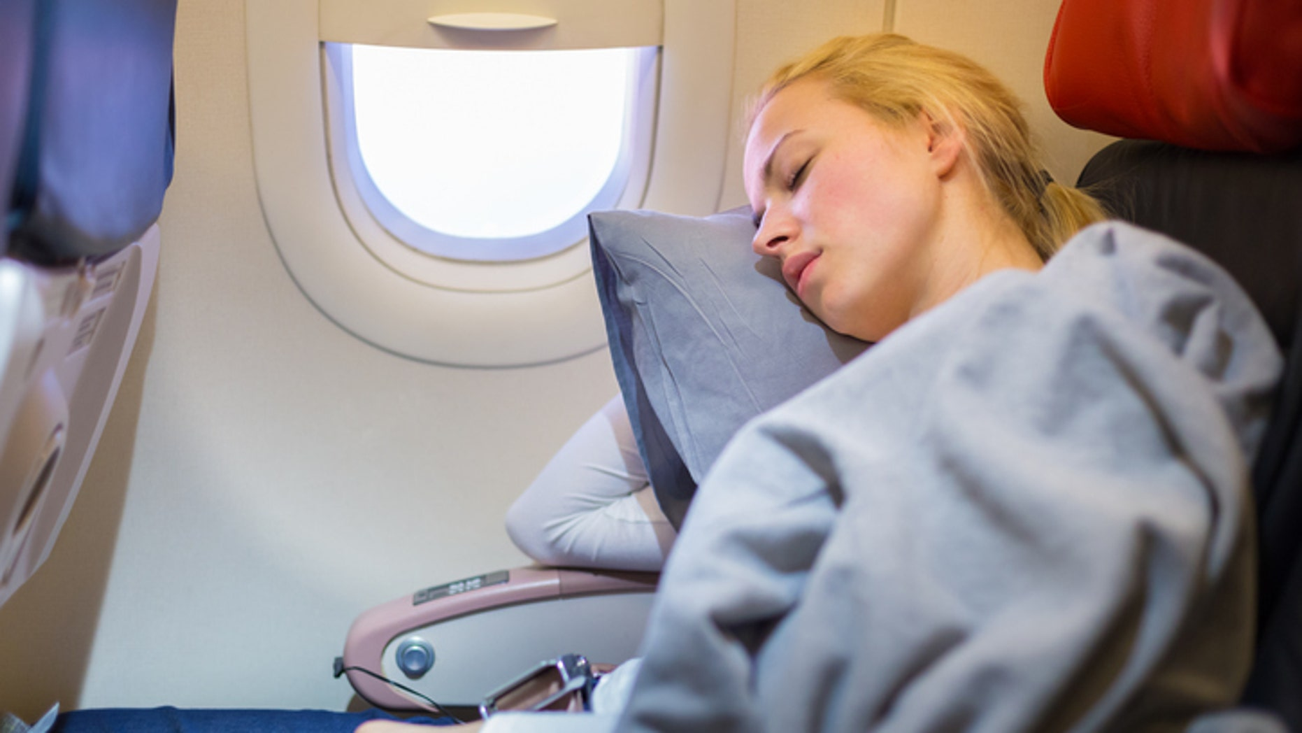 Try these tricks to catch some rest on your next flight.
