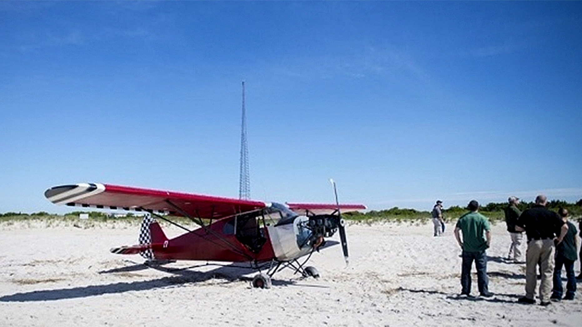 Authorities are searching for the pilot of a single-engine plane that illegally landed on a Coast Guard beach in New Jersey.