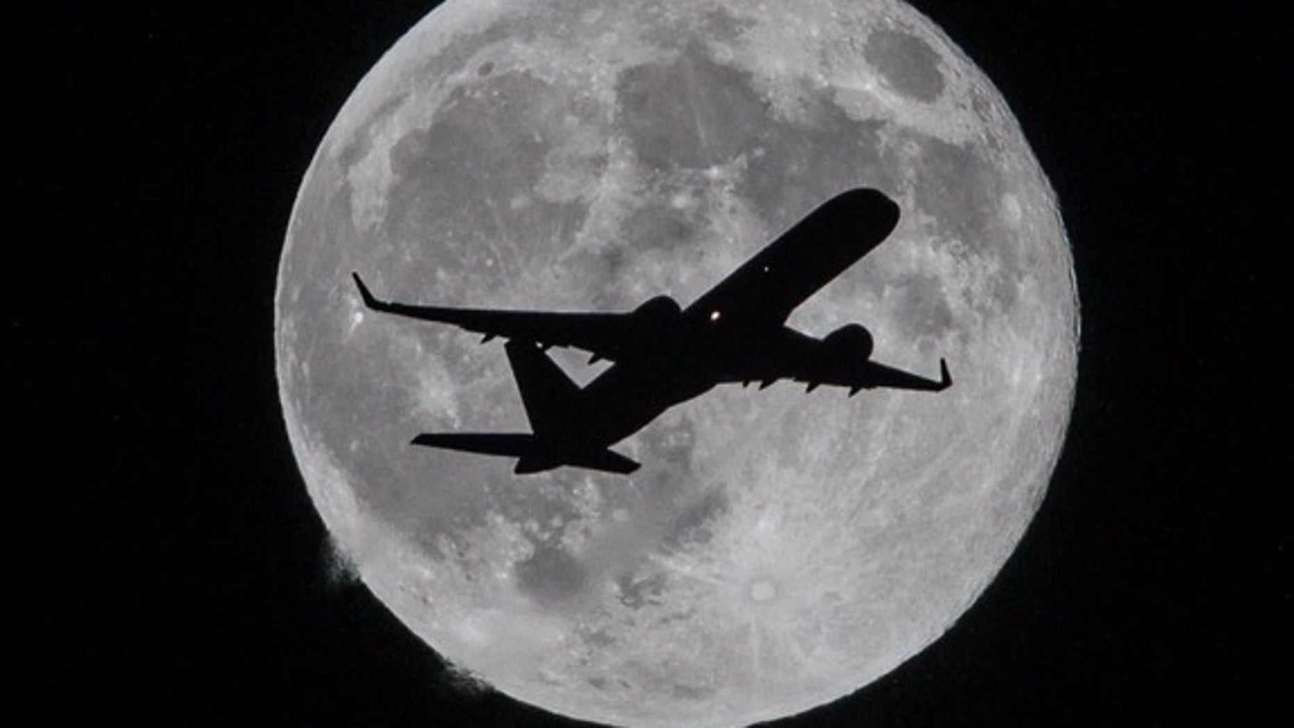 """Living right on the flight path to Los Angeles International Airport delivers stunning night sky shots of the moon for astrophotographer <a href=""""www.facebook.com/TheLunartics""""> Raul Roa </a>. Roa took the image in Whittier, Calif."""