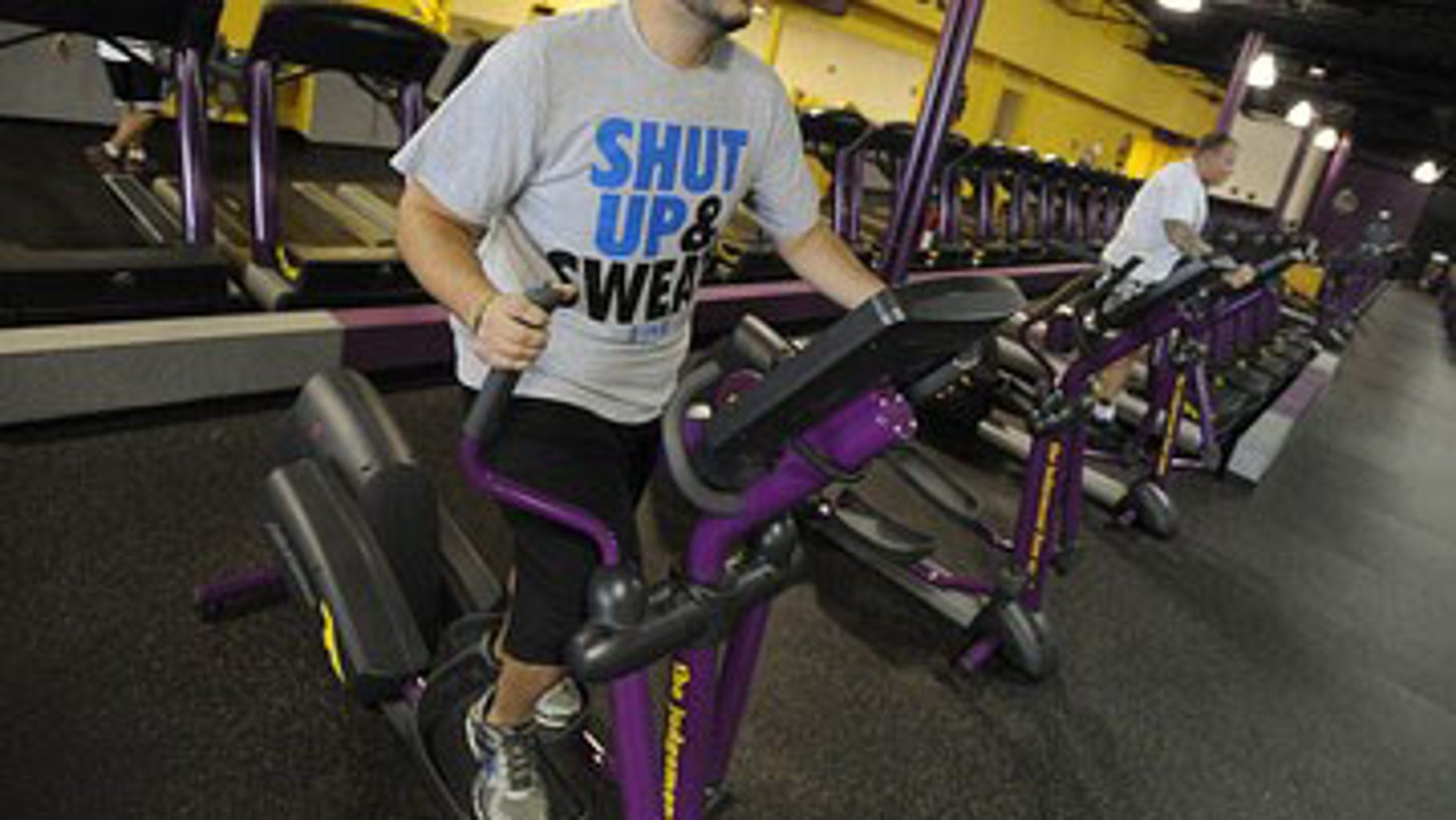 "FILE: Nathan Montgomery, a contestant from the television show ""The Biggest Loser"" works out at a Planet Fitness in Colorado Springs, Colo."