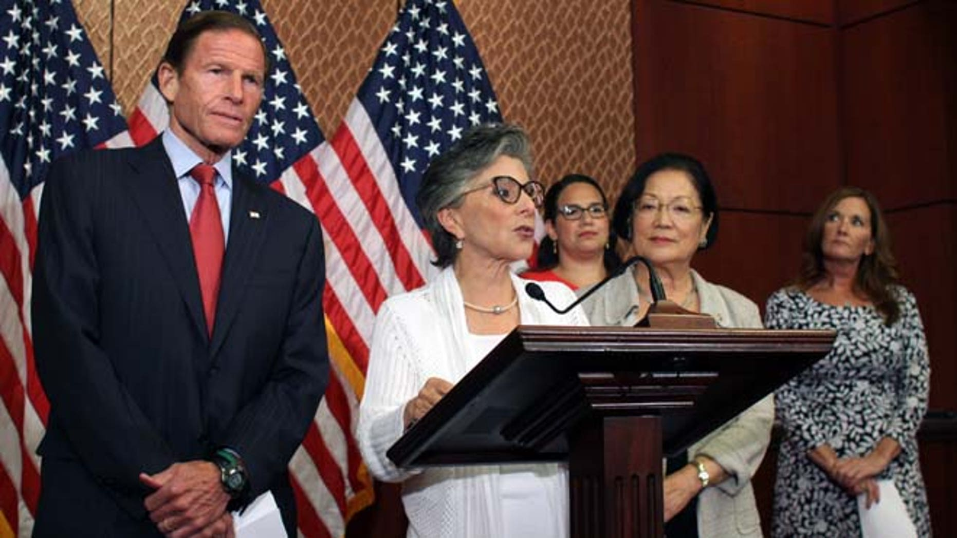 Aug. 3, 2015: Sen. Barbara Boxer, D-Calif., speaks to reporters in defense of Planned Parenthood as Sens. Richard Blumenthal, D-Conn., left, and Mazie Hirono, D-Hawaii, right, listen.