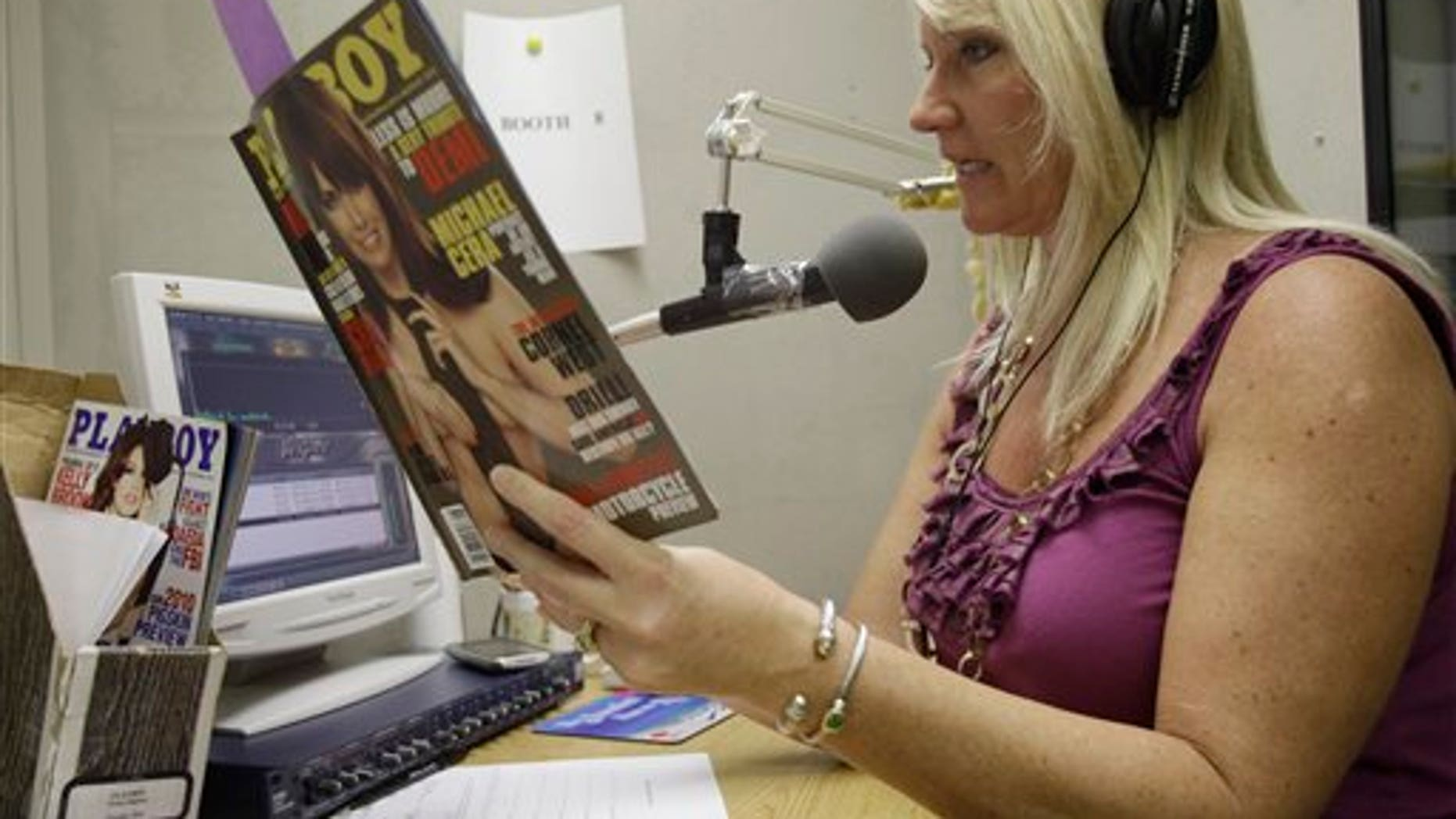 Suzi Hanks sits in a tiny sound booth demonstrating how she describes a Playboy magazine. (AP)
