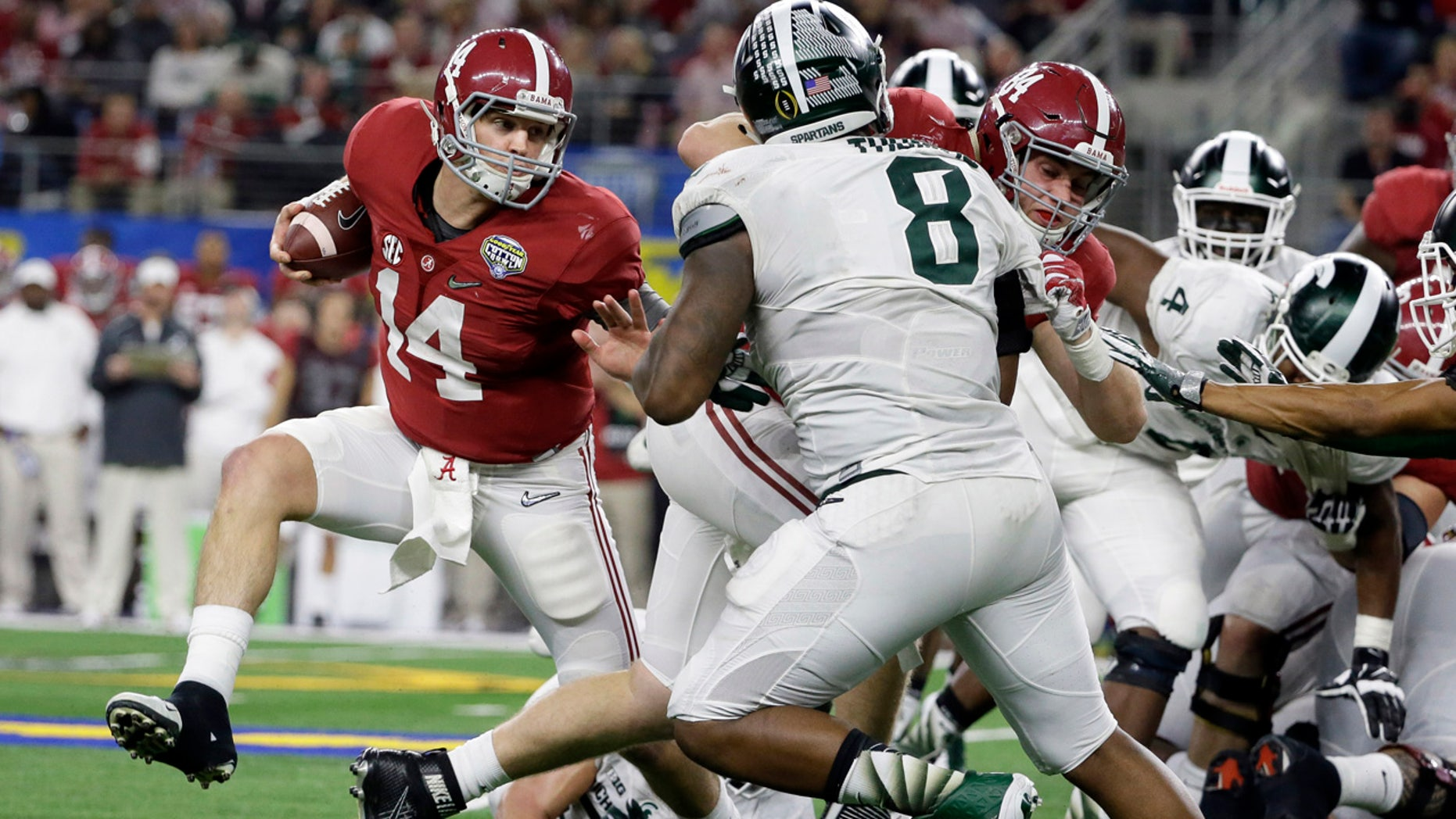 Dec. 31, 2015: Alabama quarterback Jake Coker (14) tries to escape Michigan State's defense during the second half of the Cotton Bowl NCAA college football semifinal playoff game in Arlington, Texas. (AP Photo/Tony Gutierrez)