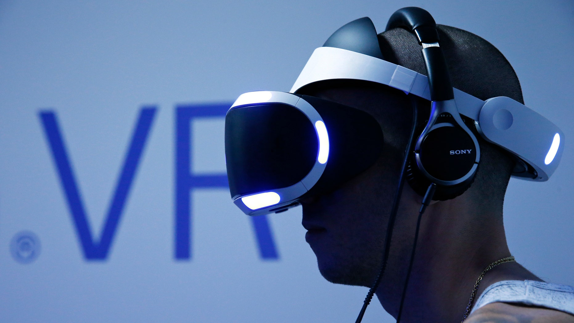 File photo - A visitor plays a game on a PlayStation VR at the Paris Games Week, a trade fair for video games in Paris, France, Oct. 28, 2015. (REUTERS/Benoit Tessier)