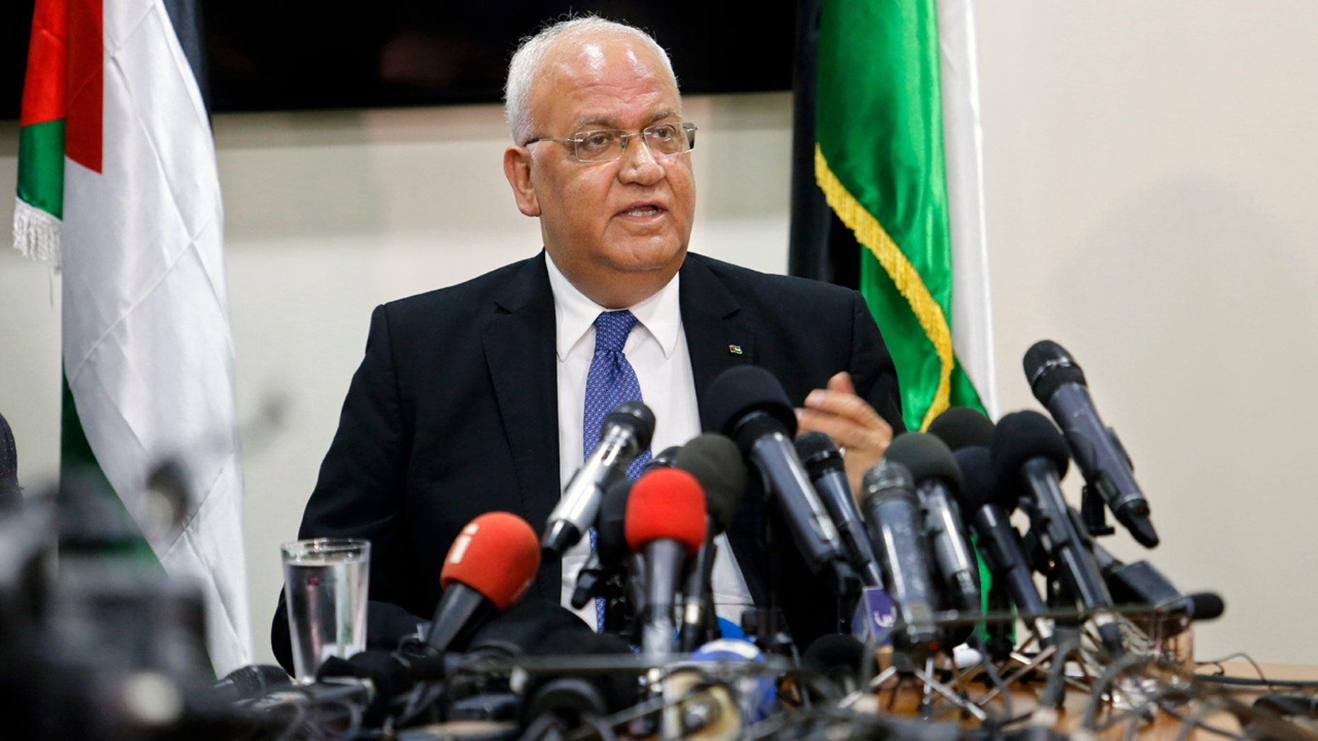 Saeb Erekat speaks to reporters in Ramallah Wednesday.