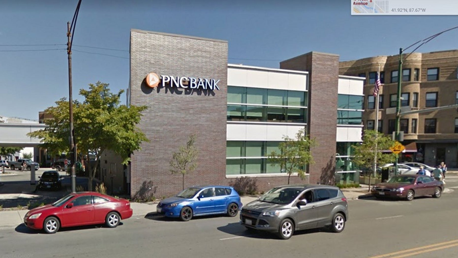 A Chicago woman died a few days after she was discovered unresponsive with her stuck in fence near a PNC Bank branch.