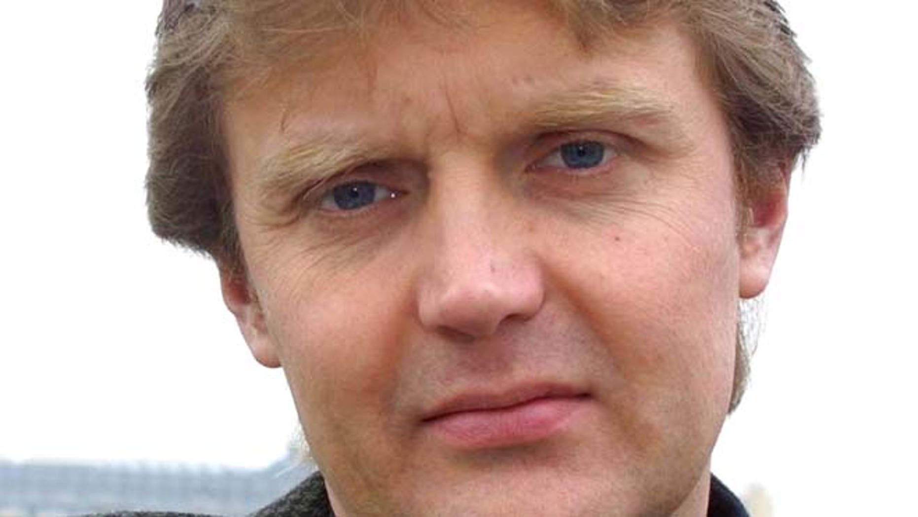 """May 10, 2002: Alexander Litvinenko, former KGB spy and author of the book """"Blowing Up Russia: Terror From Within"""" is photographed at his home in London."""