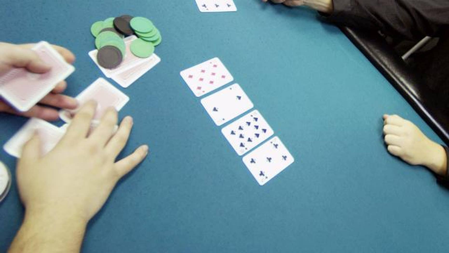 Player plays a hand at a poker club, New York.  (AP)