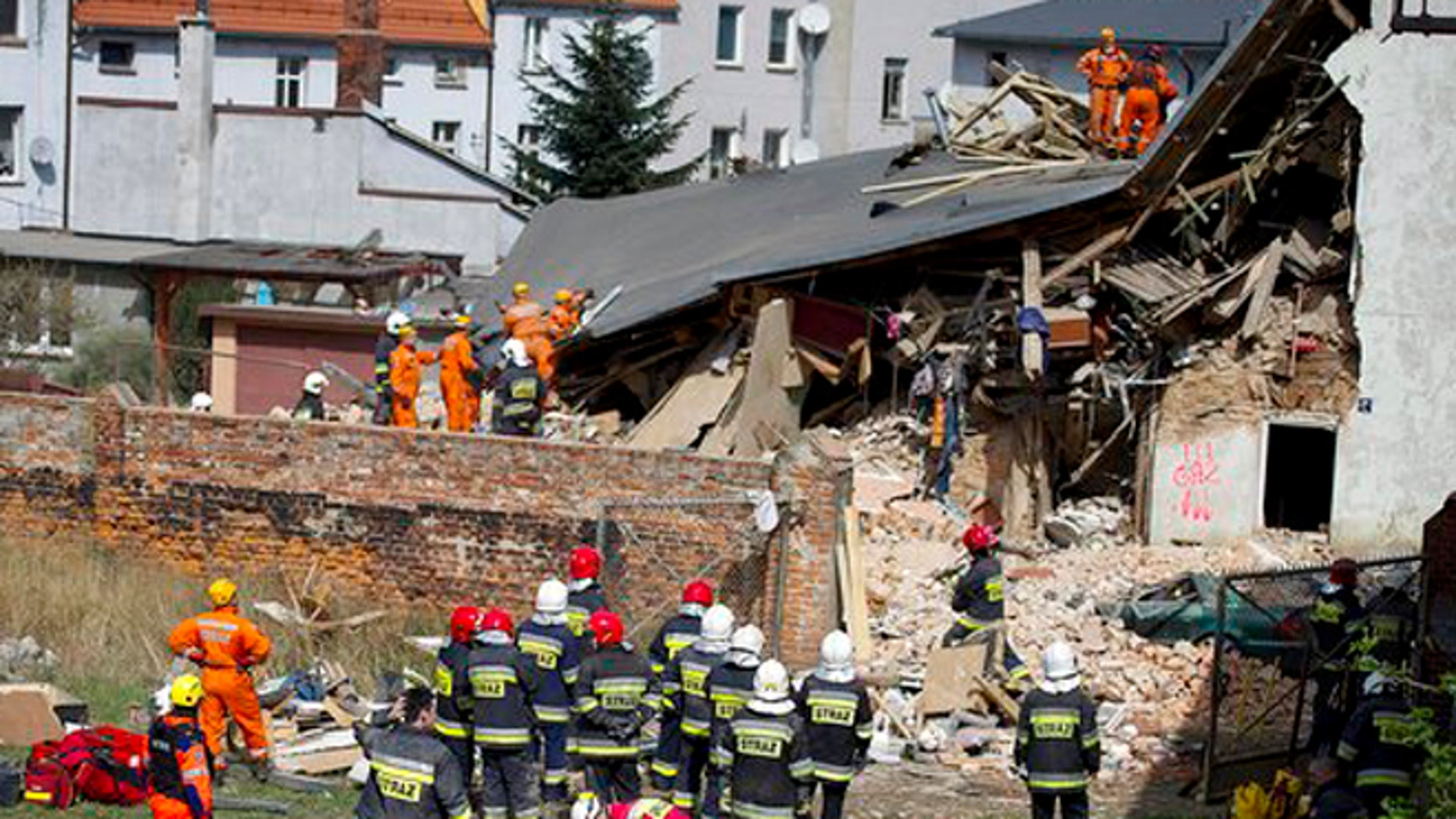 Rescuers and firefighters sift through the rubble of an apartment house that collapsed in Swiebodzice, Poland, on Saturday.