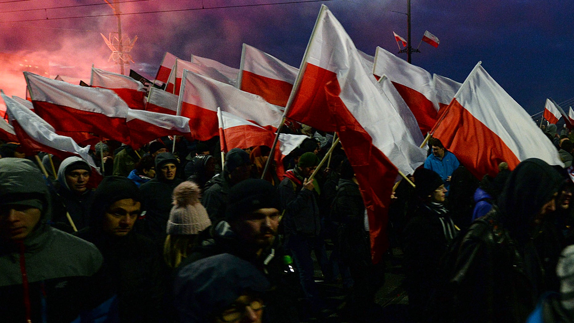 Demonstrators burned flares and waved Polish flags during the march.