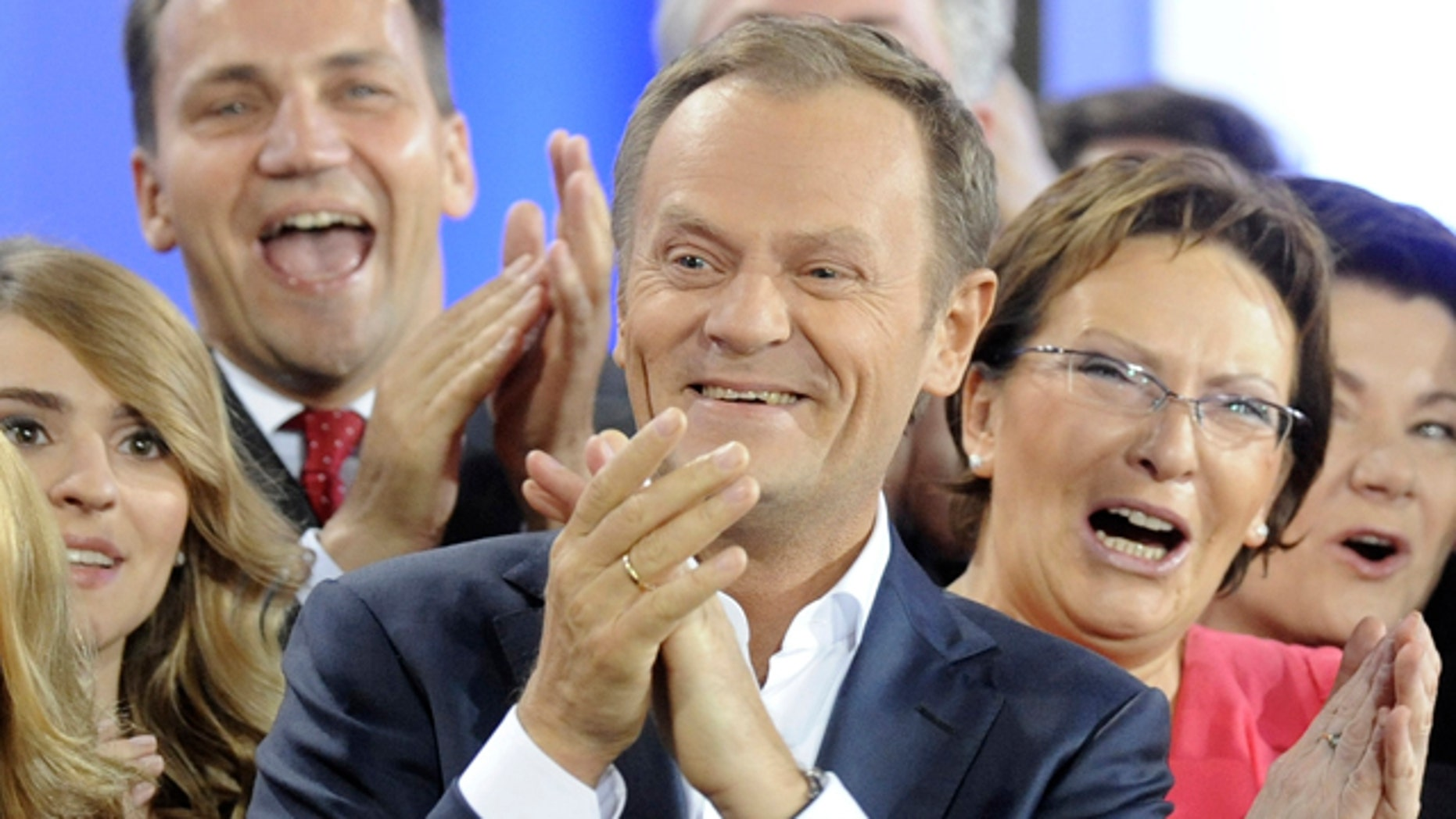 Oct. 9: Prime Minister Donald Tusk, center, celebrates with Health Minister Ewa Kopacz, right, and Foreign Minister Radek Sikorski, background left, as the first exit poll is published during the election party of Tusk's Civic Platform, a centrist and pro-EU party, in Warsaw.