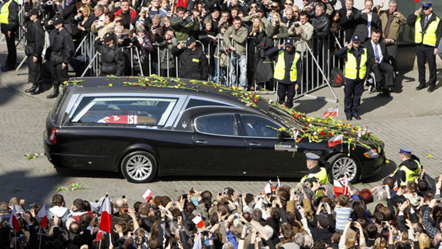 April 18: People stand along a street as a hearse carrying the coffin of the late Polish President Lech Kaczynski arrives in Krakaow, southern Poland. (AP)