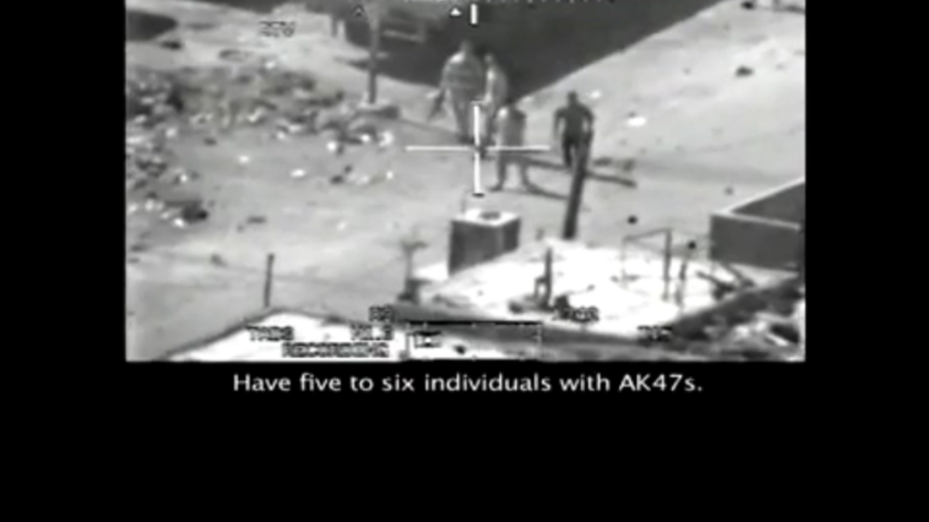This frame grab image, taken from a video posted at Wikileaks.org, shows a group of men in the streets of the New Baghdad with weapons just prior to being fired upon by a U.S. Army Apache helicopter July 12, 2007. (FNC)