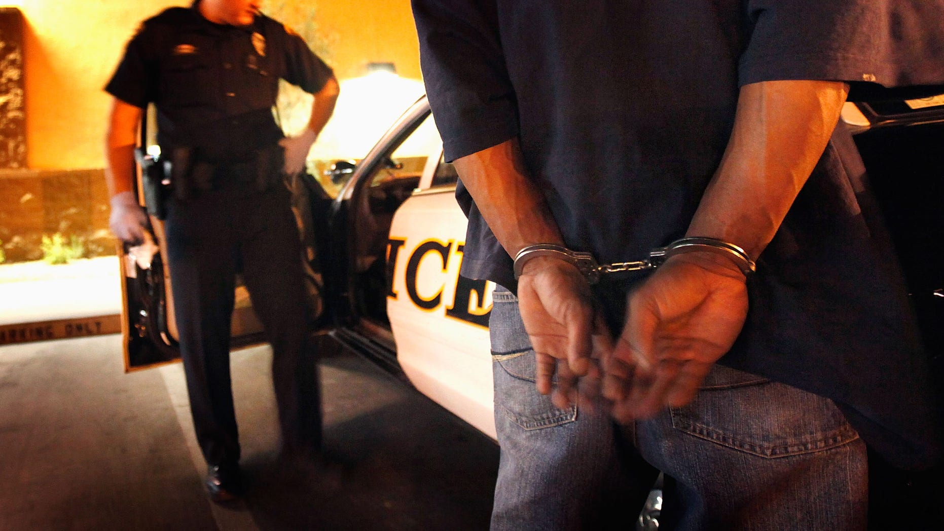 TUCSON, AZ - MAY 29:  Tucson Police Officer Angel Ramirez arrests a man for trespassing May 29, 2010 in Tucson, Arizona. Ramirez works in the city's predominately Hispanic south side. The Tucson Police Department is currently gearing up to begin training its officers on the implementation of the controversial new immigration law SB 1070. Although a Tucson police officer was one of the first to file suit in federal court challenging the new law, most rank and file officers tend to support the legislation while the Arizona Chiefs of Police have criticized it.  (Photo by Scott Olson/Getty Images)