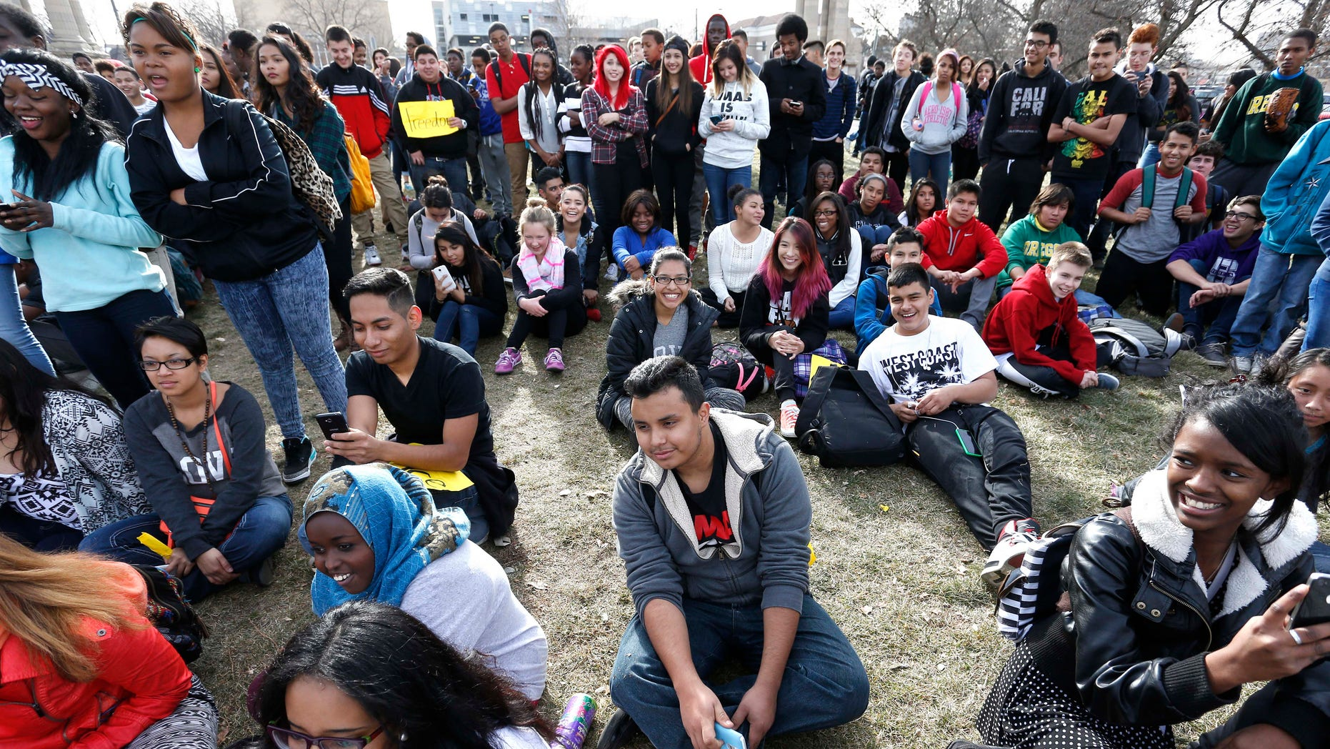 Dec. 8, 2014: South High students and supporters participate in a protest against recent grand jury decisions not to indict police officers in the killings of unarmed men, in front of East High, in Denver