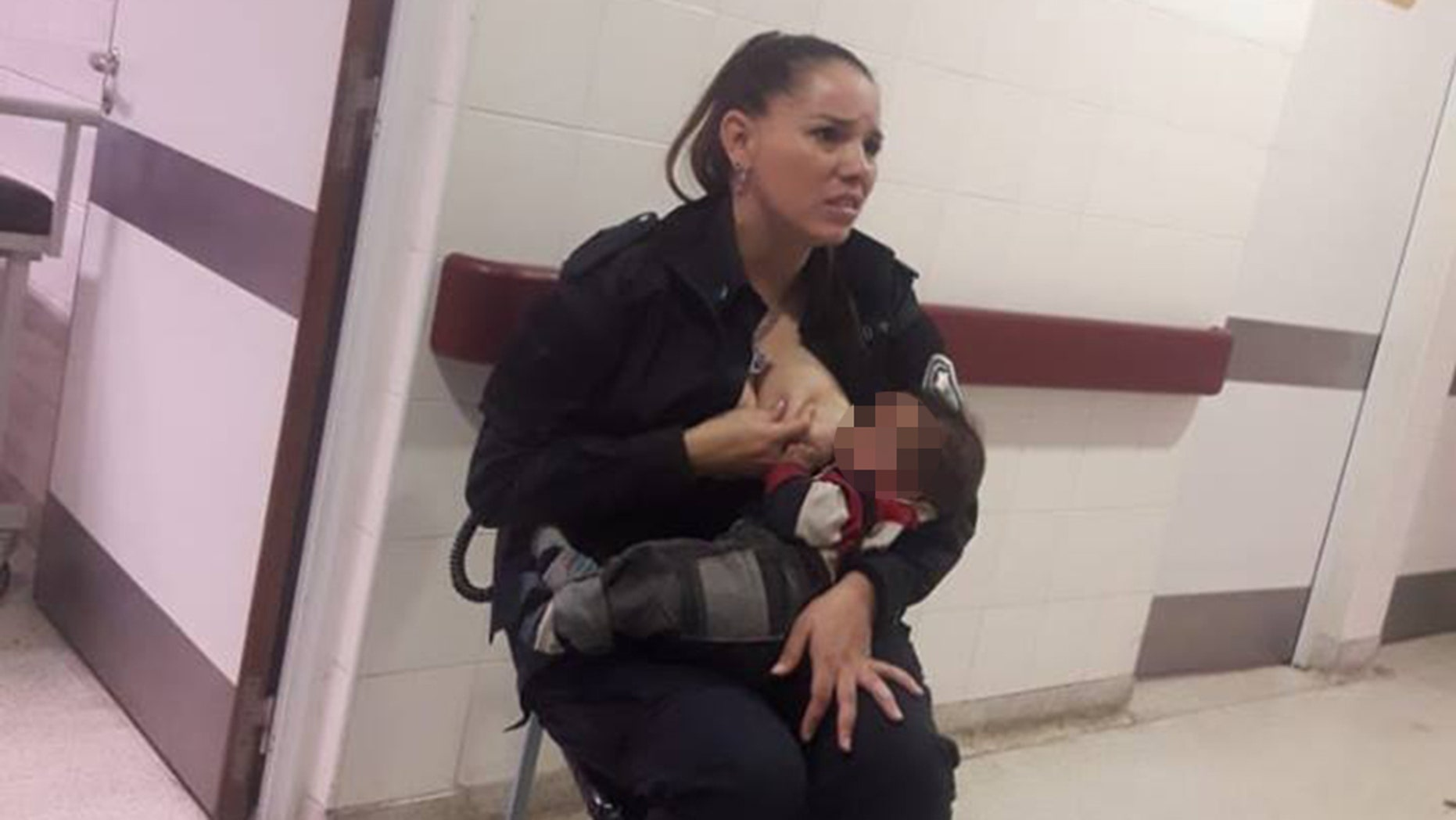 Celeste Ayala was captured breastfeeding a malnourished child.