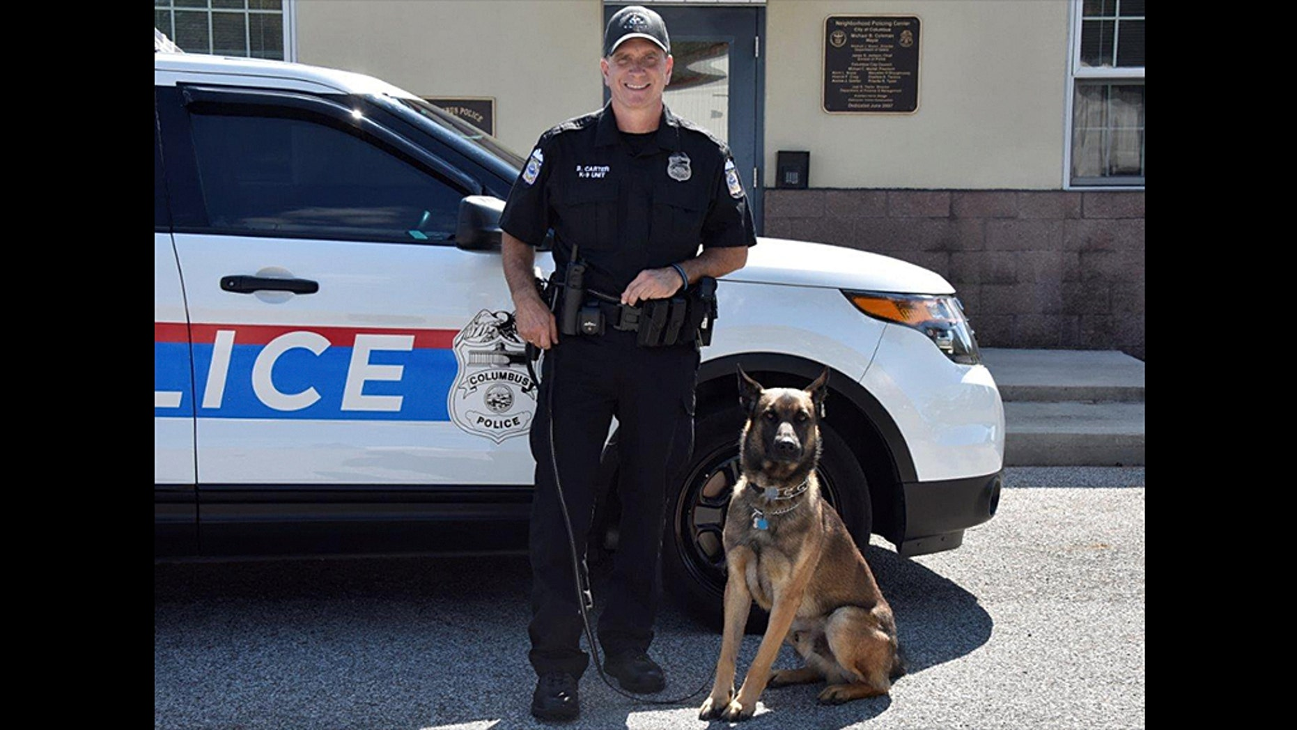 Brian Carter, an officer with the Columbus Police Department in Ohio, and his K9 partner Benzi in March 2018.