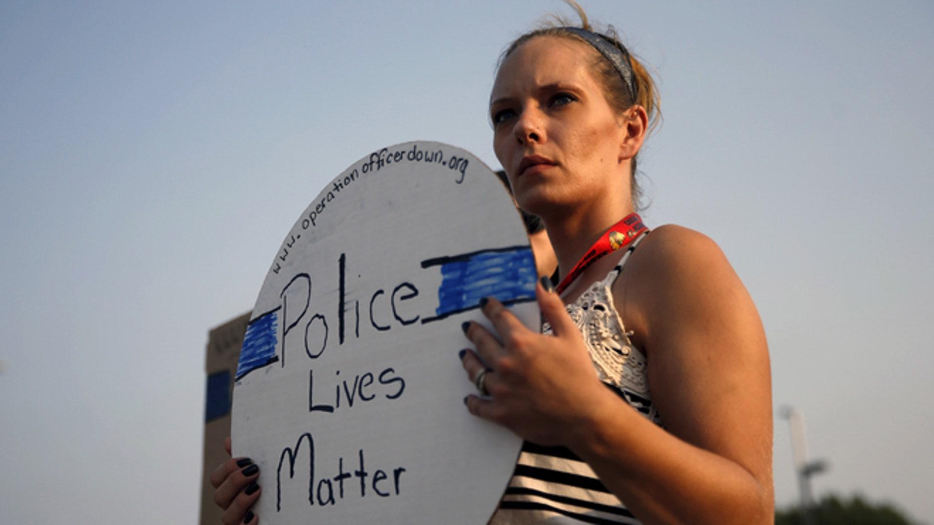 Sept. 1, 2015: A supporter of slain Fox Lake (Ill.) Police Lt. Charles Joseph Gliniewicz,  Fox Lake, Illinois.