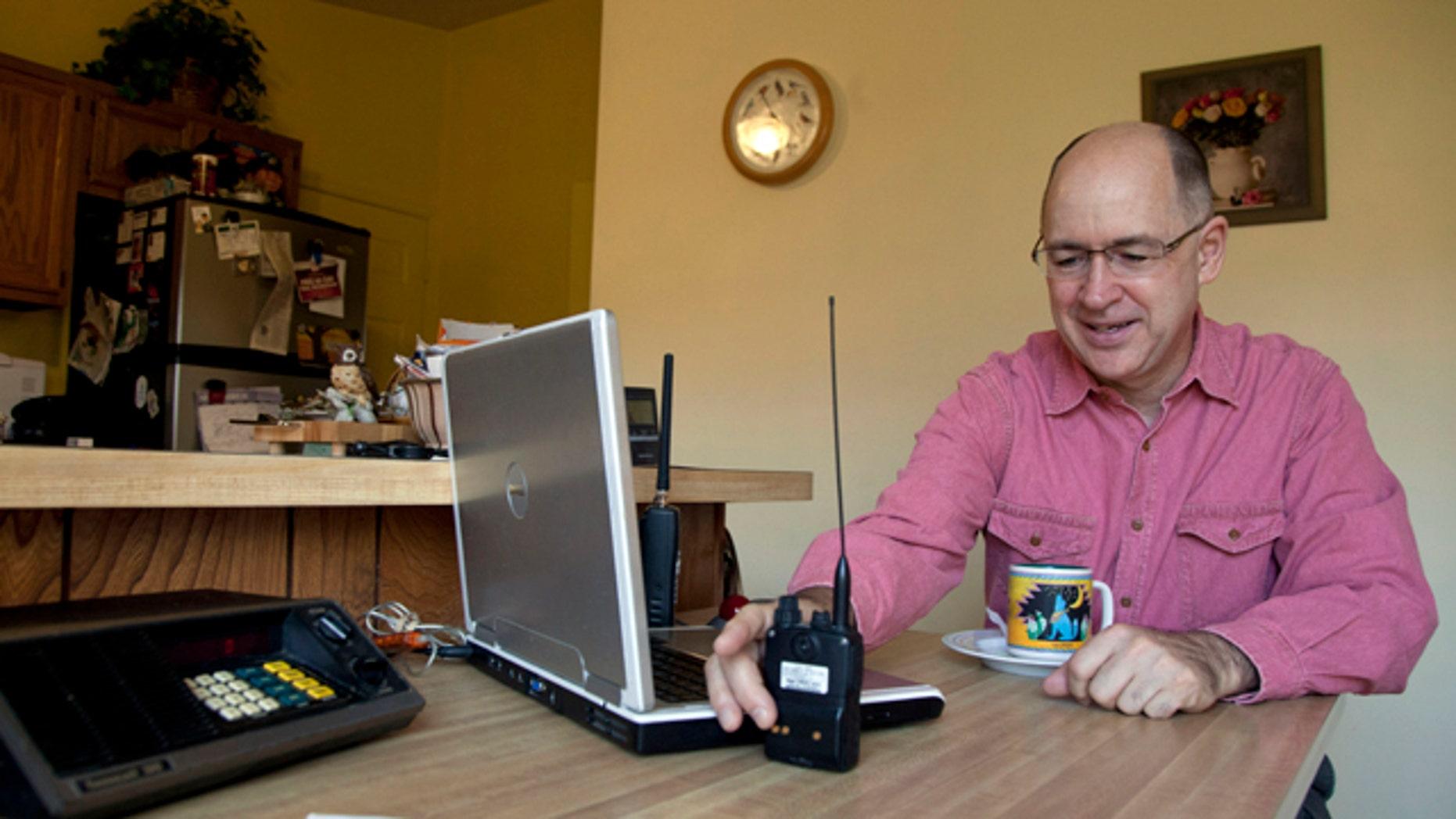 19, 2011: Scanner hobbyist Rick Hansen holds his scanner/Ham radio
