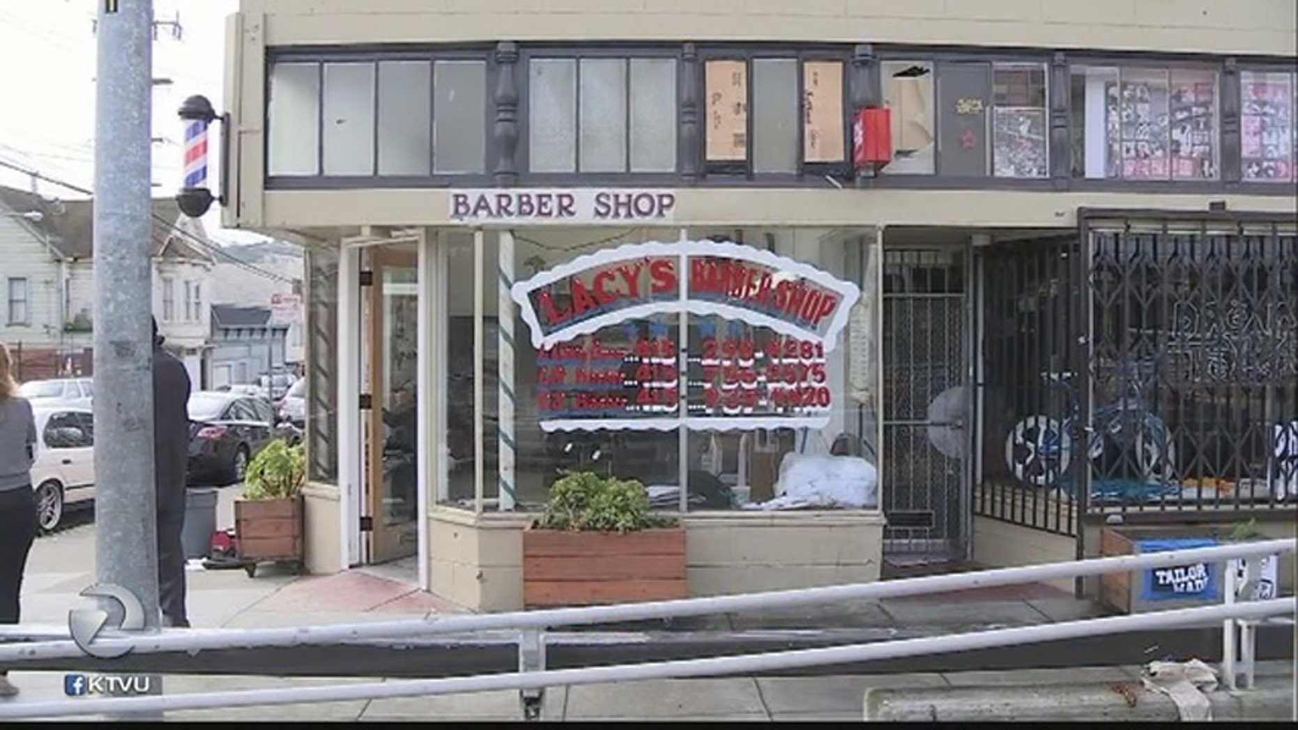 Lacy's Barberhshop, whose windows were shattered during a recently deadly shooting.